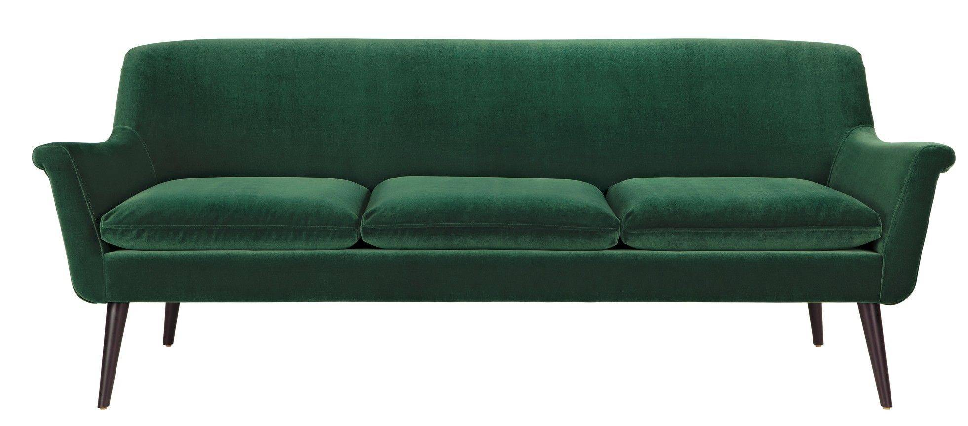 For the daring among us, an emerald sofa is the ticket to this year's color trend.