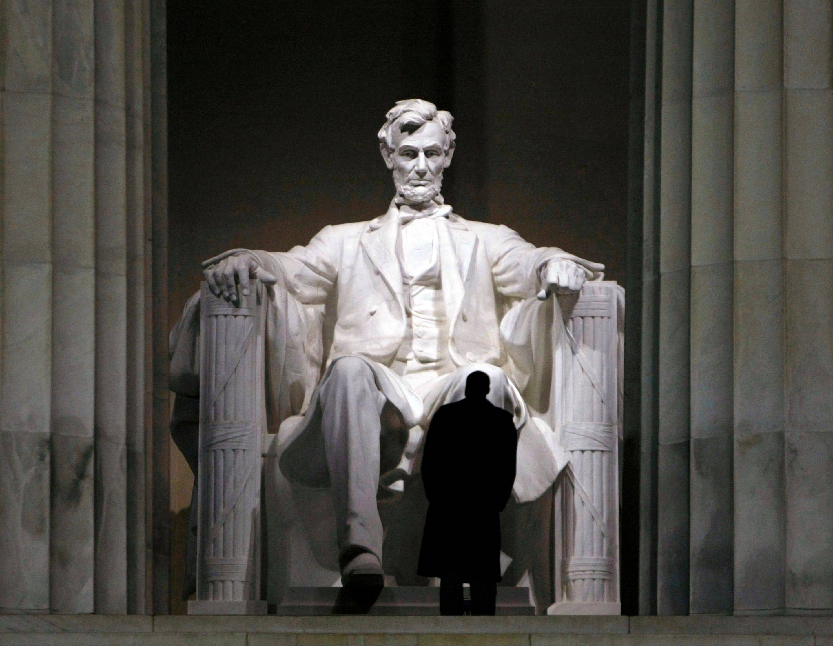 A Secret Service agent stands watch while President-elect Barack Obama, not shown, visits the Lincoln Memorial with his family in Washington. The 16th president was one of America's most admired, rising from humble roots in a frontier cabin to become a self-educated lawyer and brilliant politician.