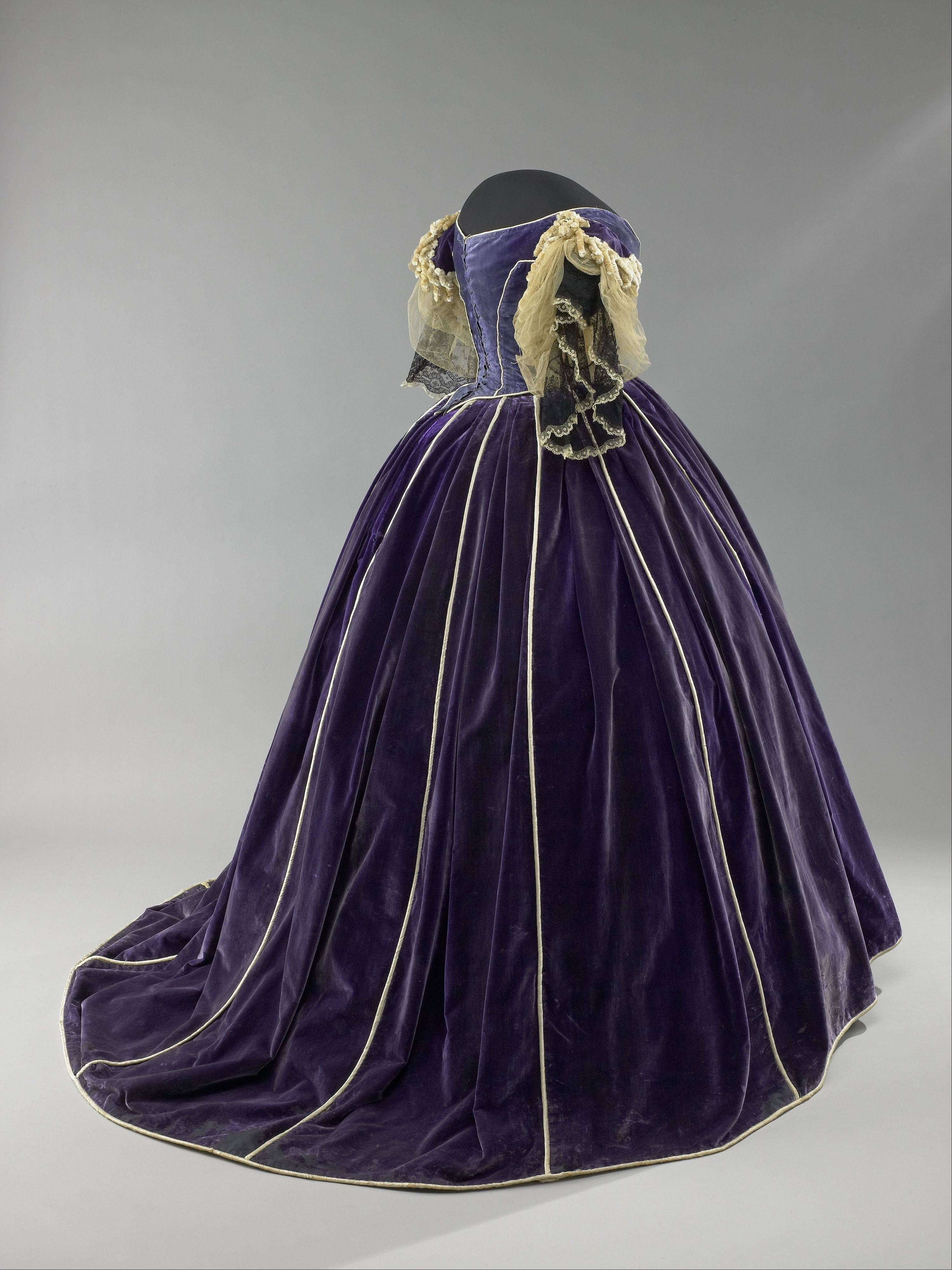 "Mary Todd Lincoln's purple velvet gown, displayed in ""The First Ladies"" exhibit, was made by her seamstress and confidante, Elizabeth Keckley, an African-American woman who had purchased her own freedom."