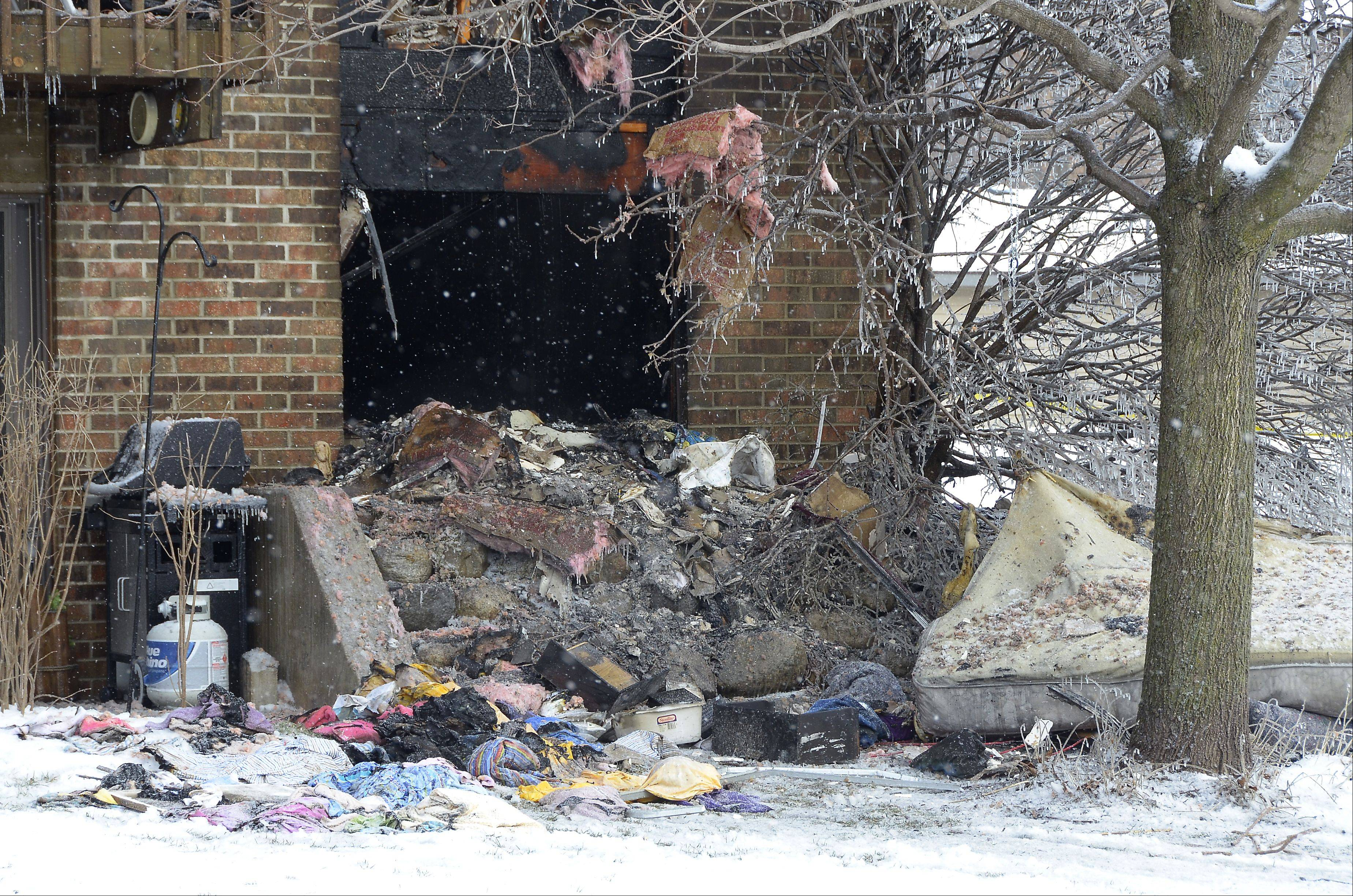 Debris is left at the scene of a fatal apartment fire Sunday morning in the Woodcreek Apartments complex in Huntley. Officials said one man was killed and about a dozen other residents were displaced by the early morning fire.