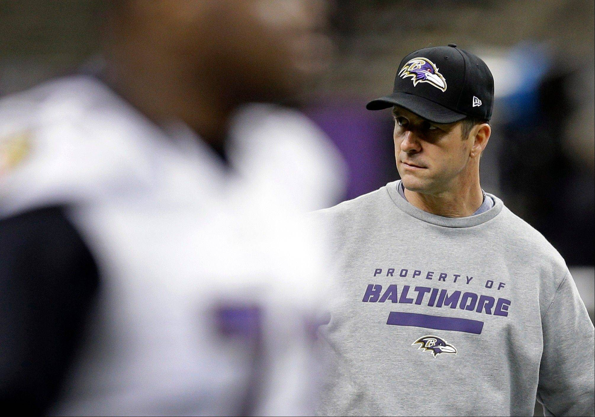 Baltimore Ravens head coach John Harbaugh looks on as his players participate in an NFL Super Bowl XLVII walkthrough.