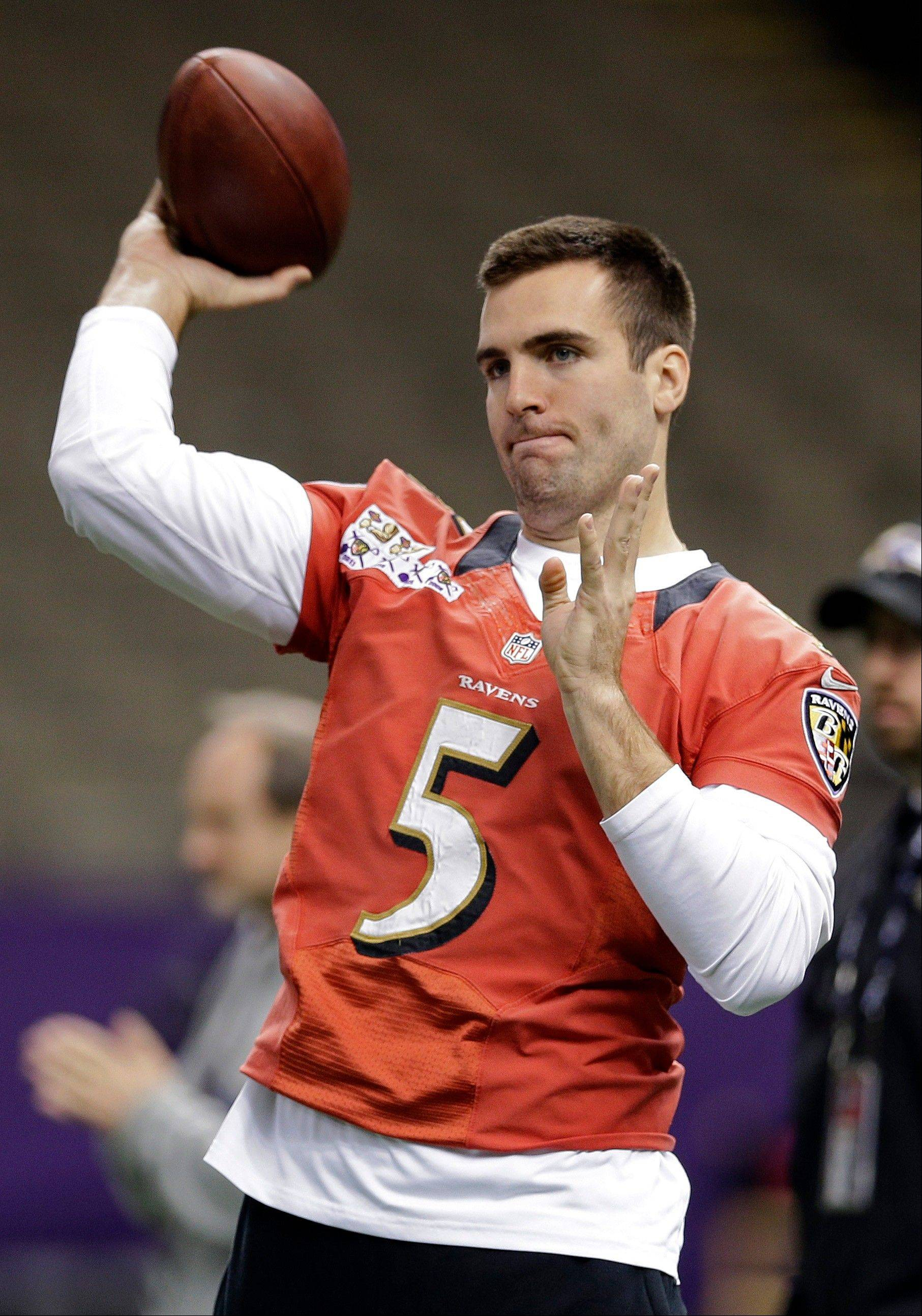 Baltimore Ravens quarterback Joe Flacco throws a pass during an NFL Super Bowl XLVII walkthrough on Saturday.