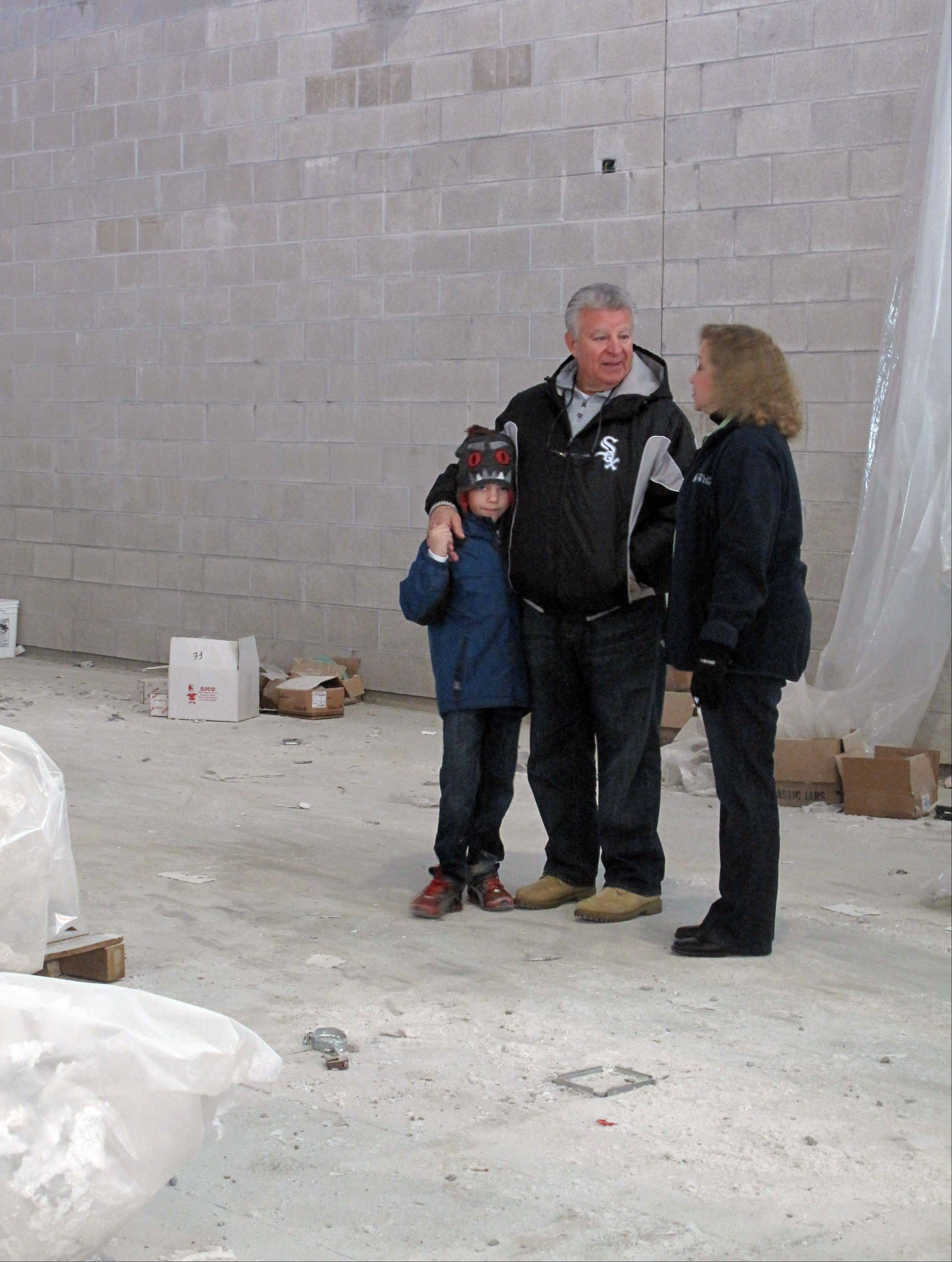 Carol Stream Village President Frank Saverino and his 6-year-old son Dominic Saverino tour the Fountain View Recreation Center on Saturday with Carol Stream park board President Brenda Gramann. Construction began in October 2011 and is expected to be complete this summer.