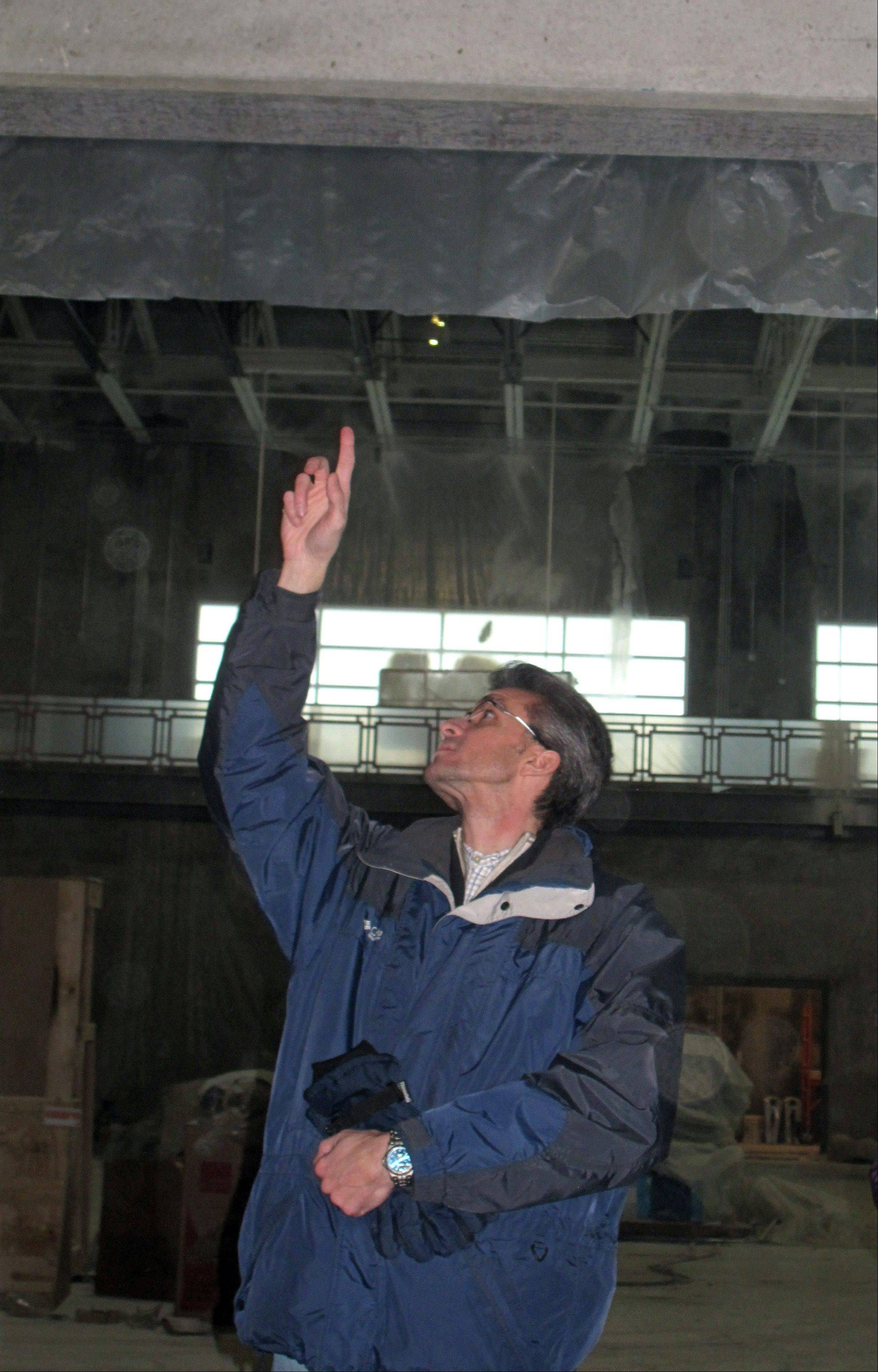Architect Frank Parisi points out skylights that will help sunlight flow into the Fountain View Recreation Center in Carol Stream so the facility can use less energy for lighting. The $18 million 90,846-square-foot recreation center is scheduled to be complete by summer with a grand opening in August or September.