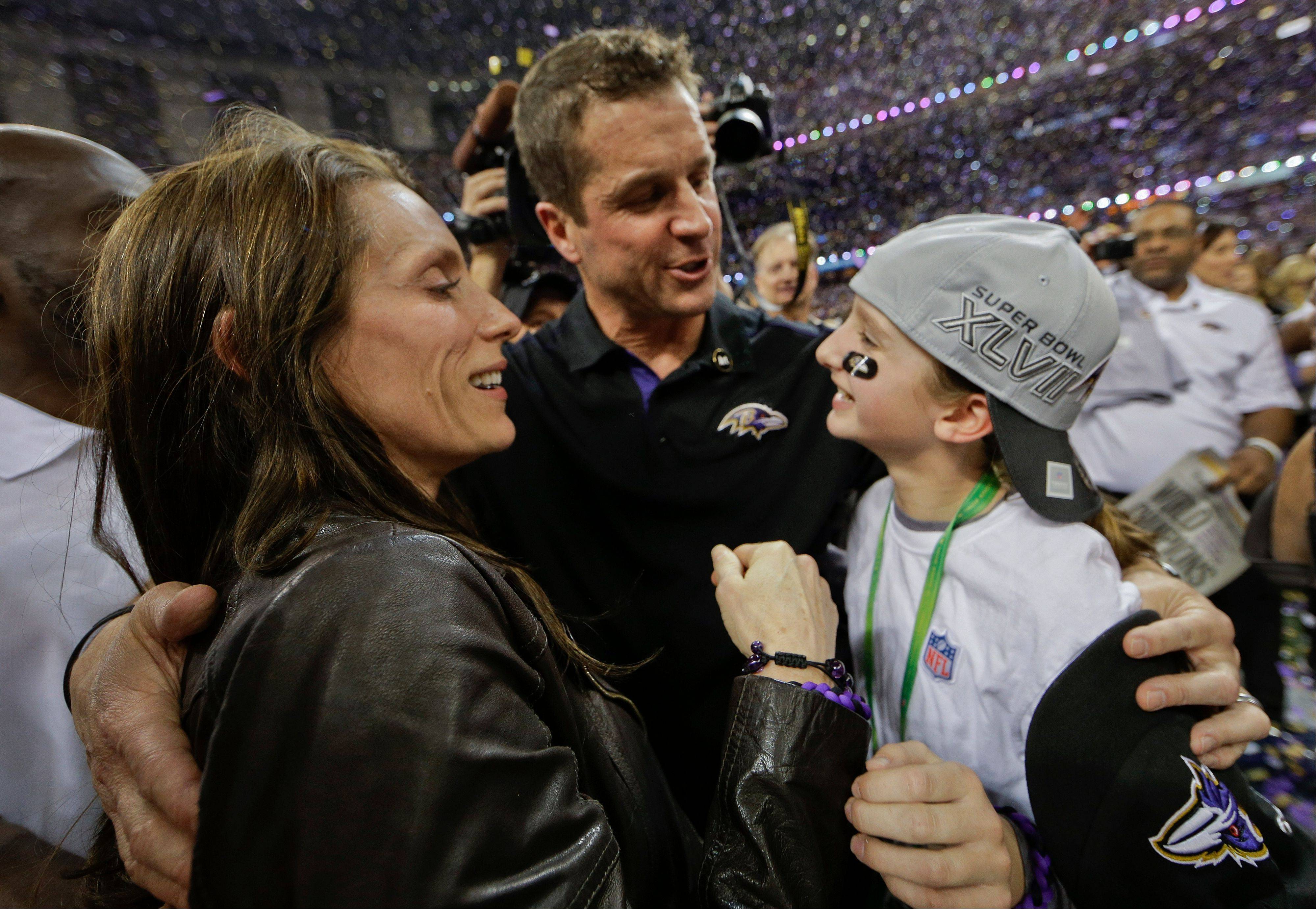 Baltimore Ravens head coach John Harbaugh hugs his wife, Ingrid, and daughter, Alison, after defeating the San Francisco 49ers 34-31 in the Super Bowl.