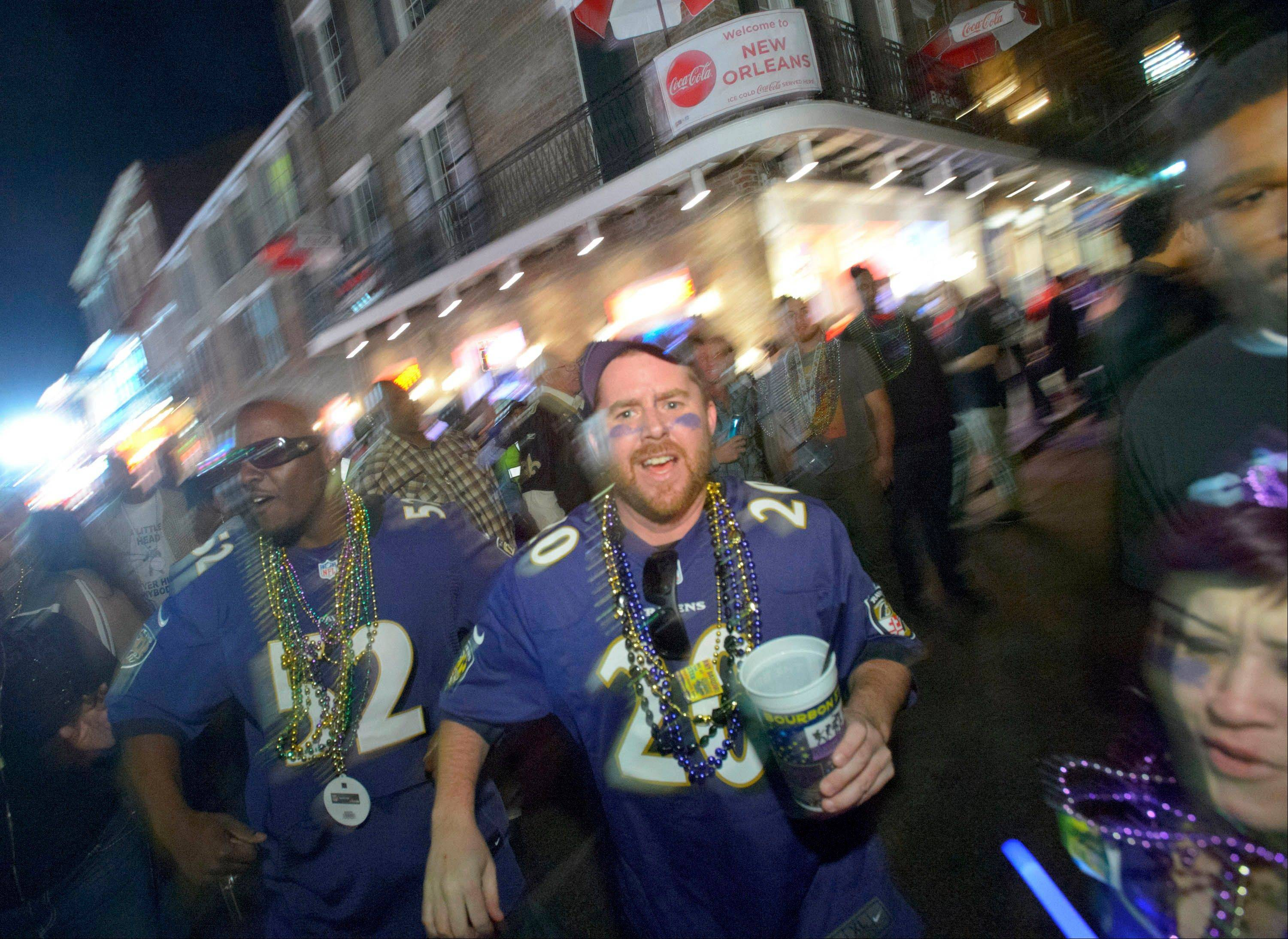 Baltimore Ravens fans celebrate the team's Super Bowl victory Sunday night on Bourbon Street in New Orleans.
