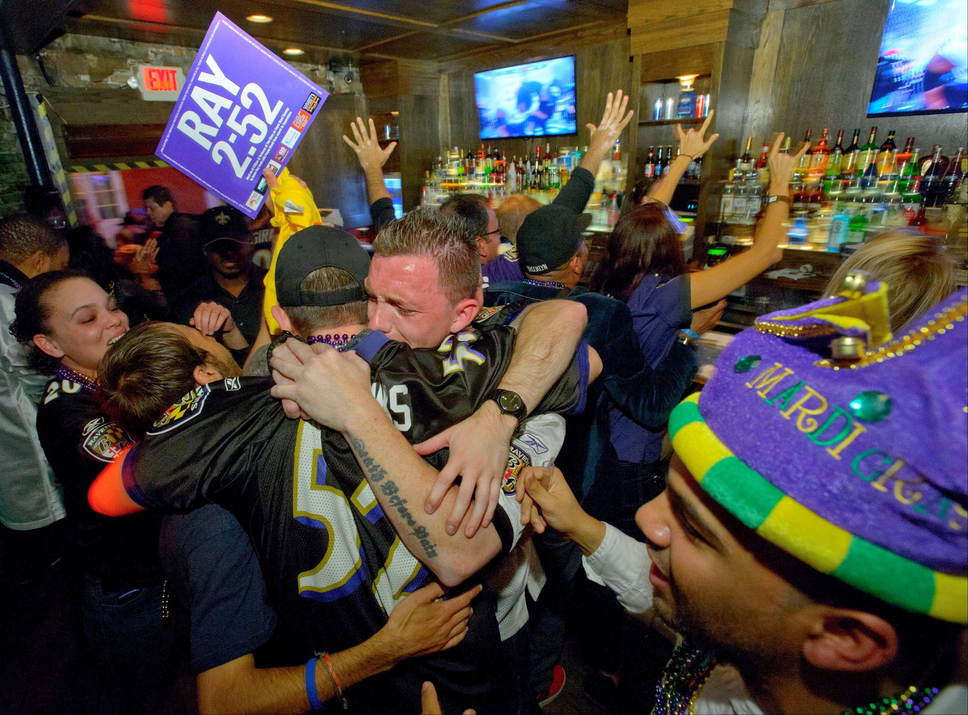 Lee Fuller of Baltimore, center, and others celebrate the Ravens' Super Bowl triumph on Sunday at the Famous Door Bar on Bourbon Street in New Orleans