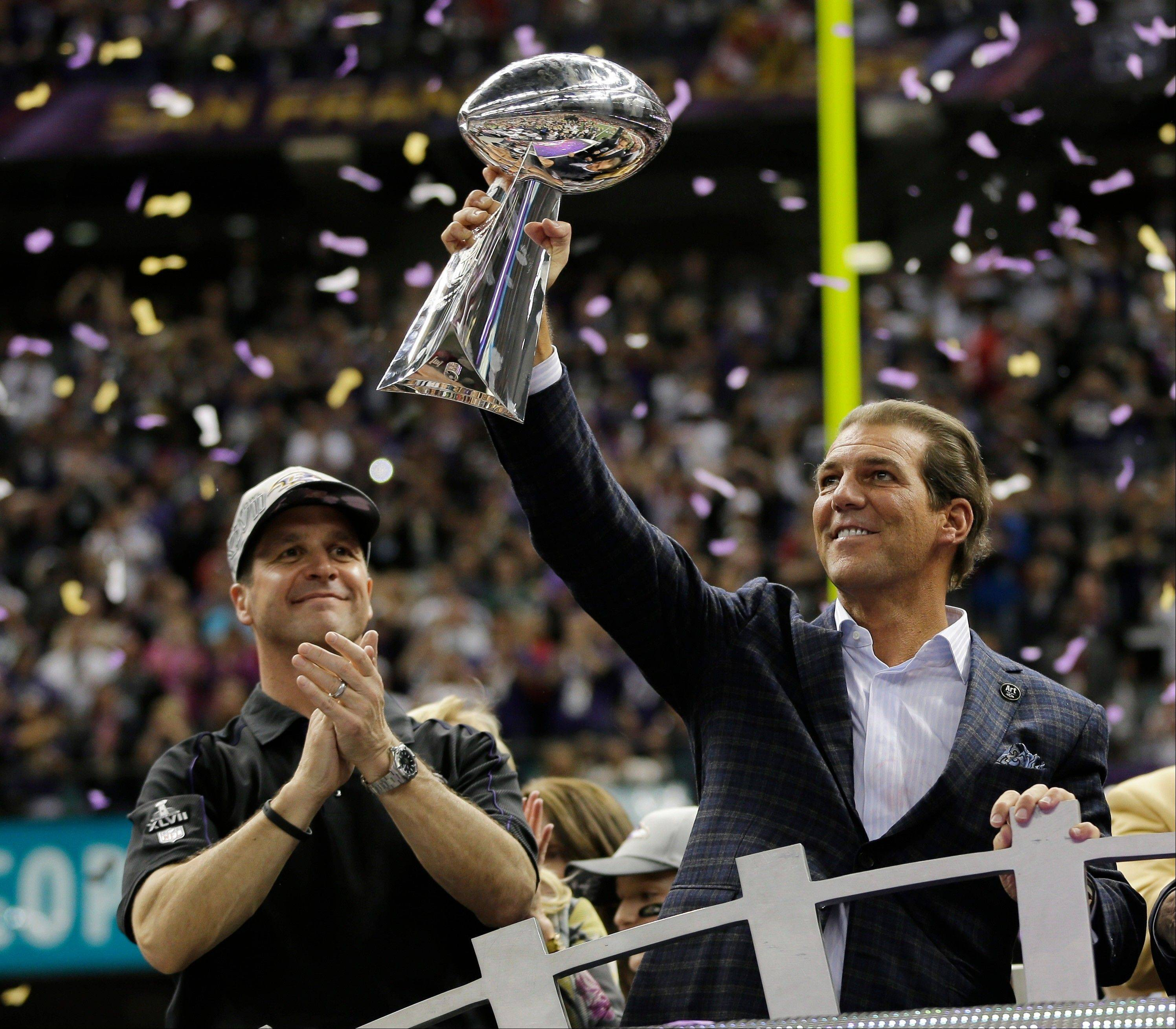 Baltimore Ravens owner Stephen J. Bisciotti holds up the Vince Lombardi Trophy after the team's 34-31 win against the San Francisco 49ers in Super Bowl XLVII.