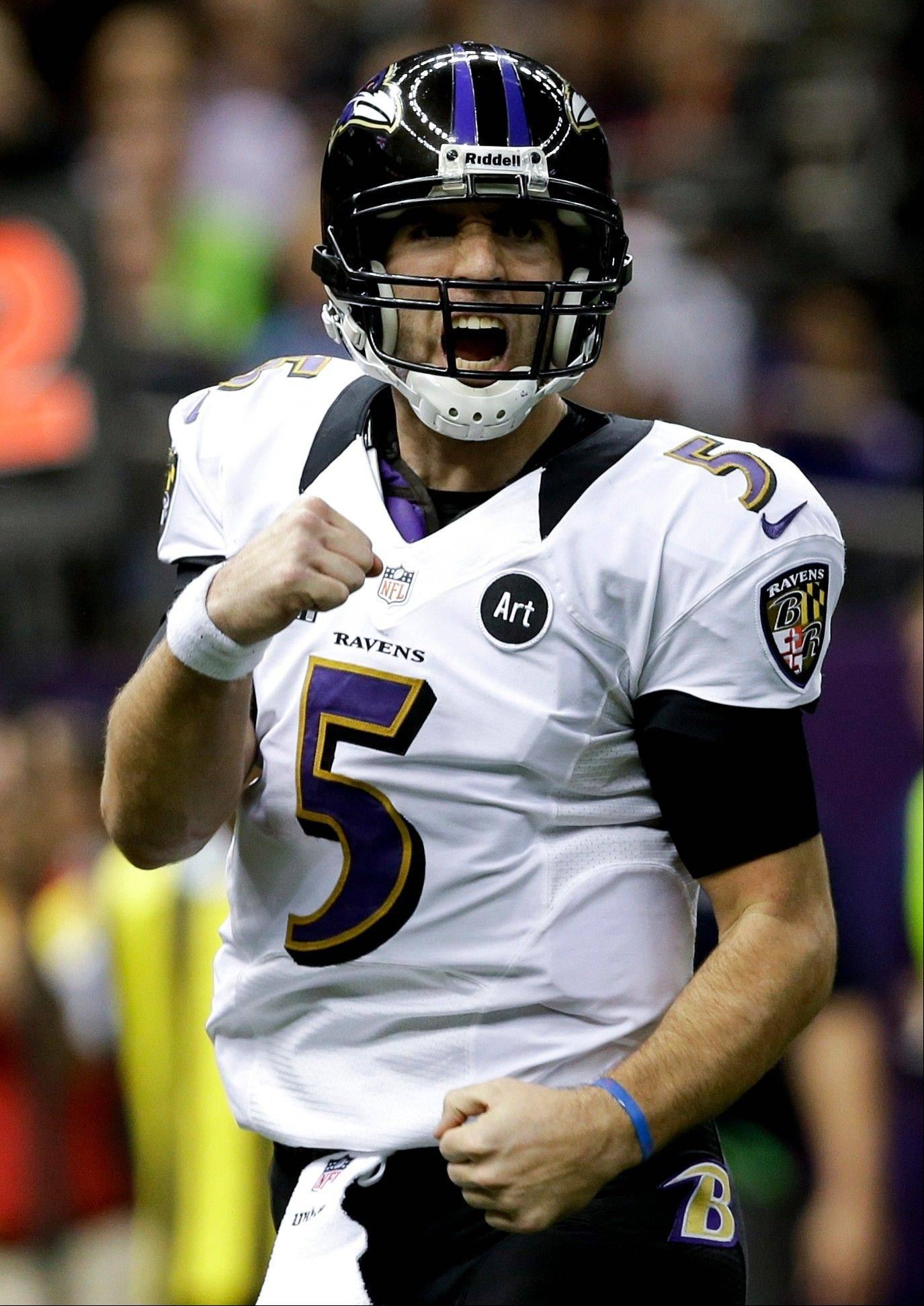 Ravens quarterback Joe Flacco celebrates a touchdown against the San Francisco 49ers during the first half of Super Bowl XLVII on Sunday in New Orleans. Flacco threw three TDs in the first half.