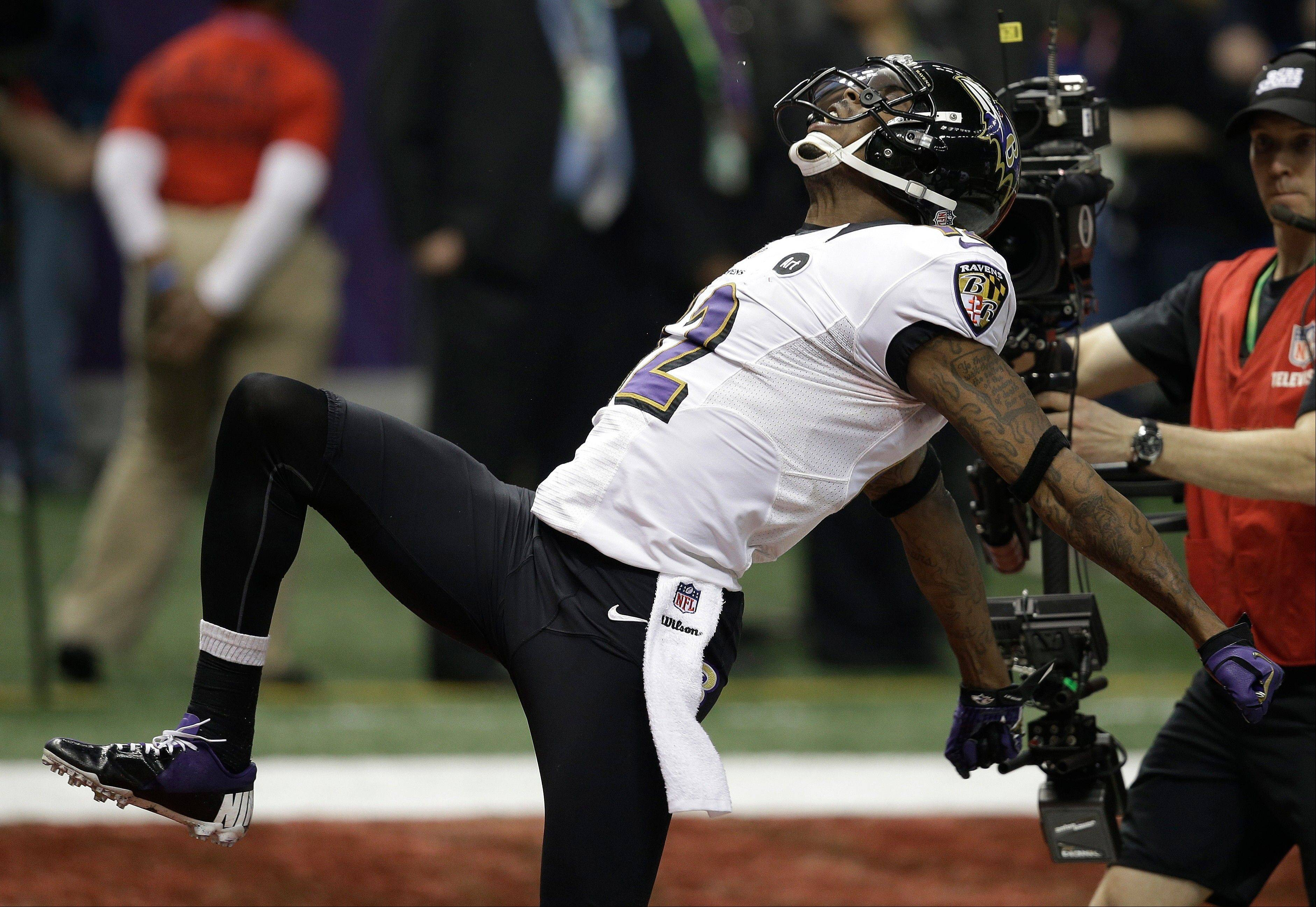 Baltimore Ravens wide receiver Jacoby Jones celebrates after returning a kickoff for a 108-yard touchdown against the San Francisco 49ers top open the second half of the Super Bowl on Sunday.