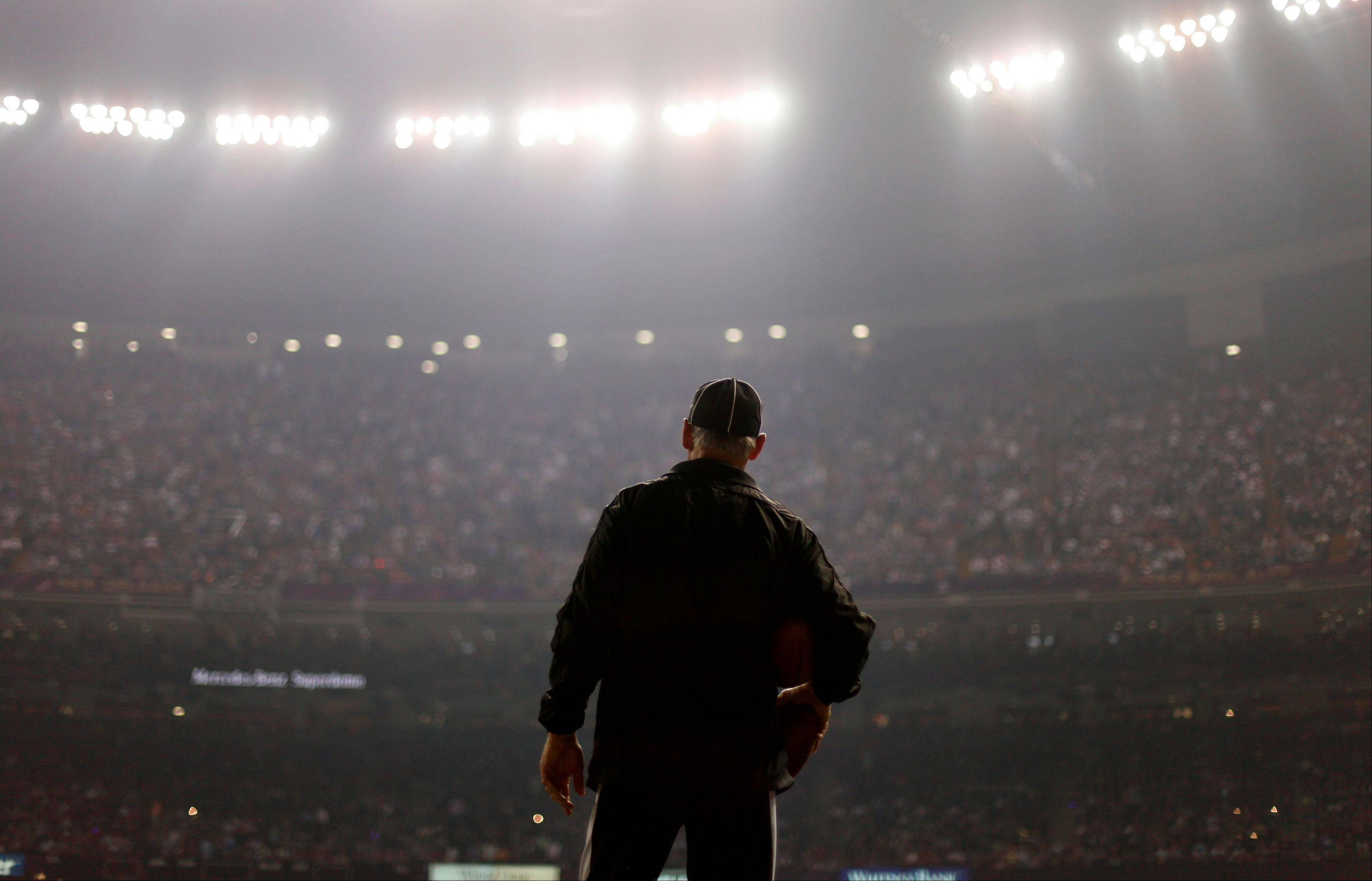 An official looks on during a Superdome power outage in the second half of the NFL Super Bowl XLVII on Sunday. The outage provided a major glitch to what has largely been viewed as a smooth week for New Orleans.
