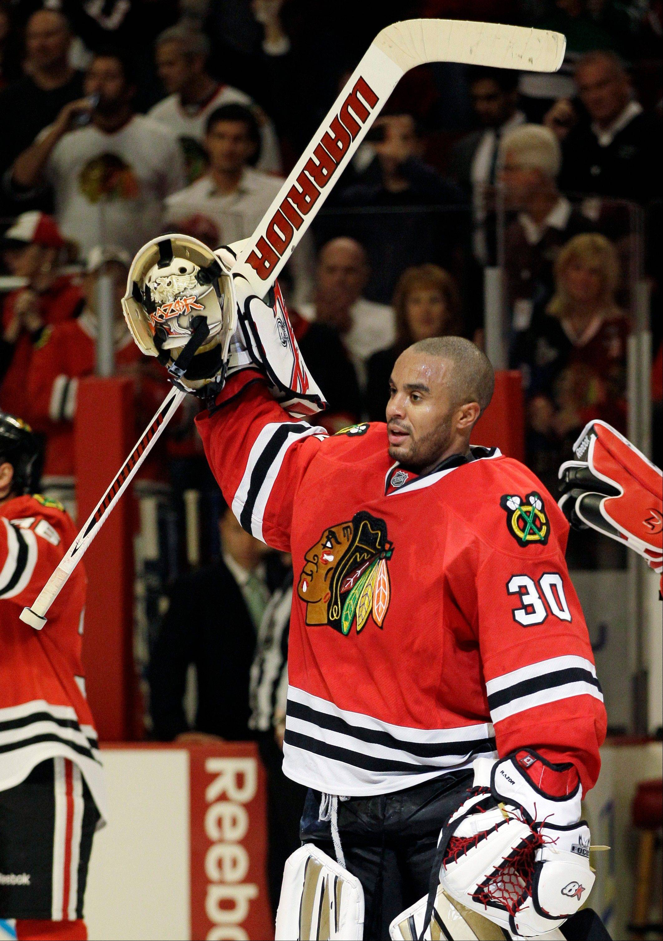 Goalie Ray Emery was showered with praise by his teammates after his brilliant 45-save performance Saturday when the Blackhawks beat the host Calgary Flames 3-2 in a shootout.
