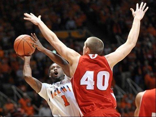Illinois' guard D.J. Richardson (1) tries to shoot past Wisconsin's forward/center Jared Berggren (40) in the first half Sunday at Assembly Hall in Champaign.