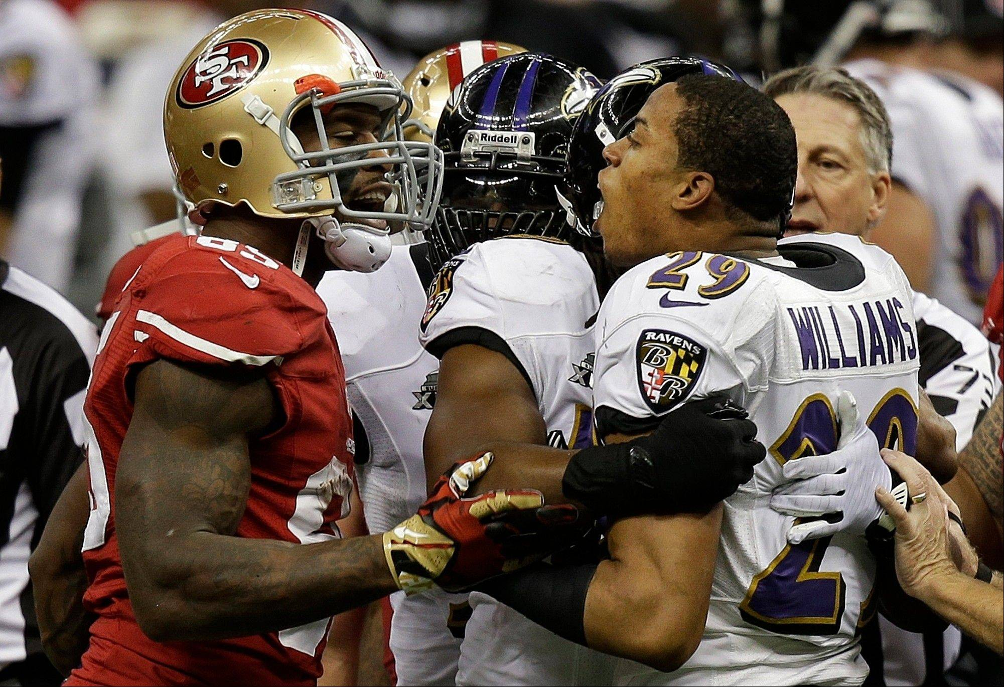 San Francisco 49ers tight end Vernon Davis (85) and Baltimore Ravens cornerback Cary Williams (29) argue during the first half.