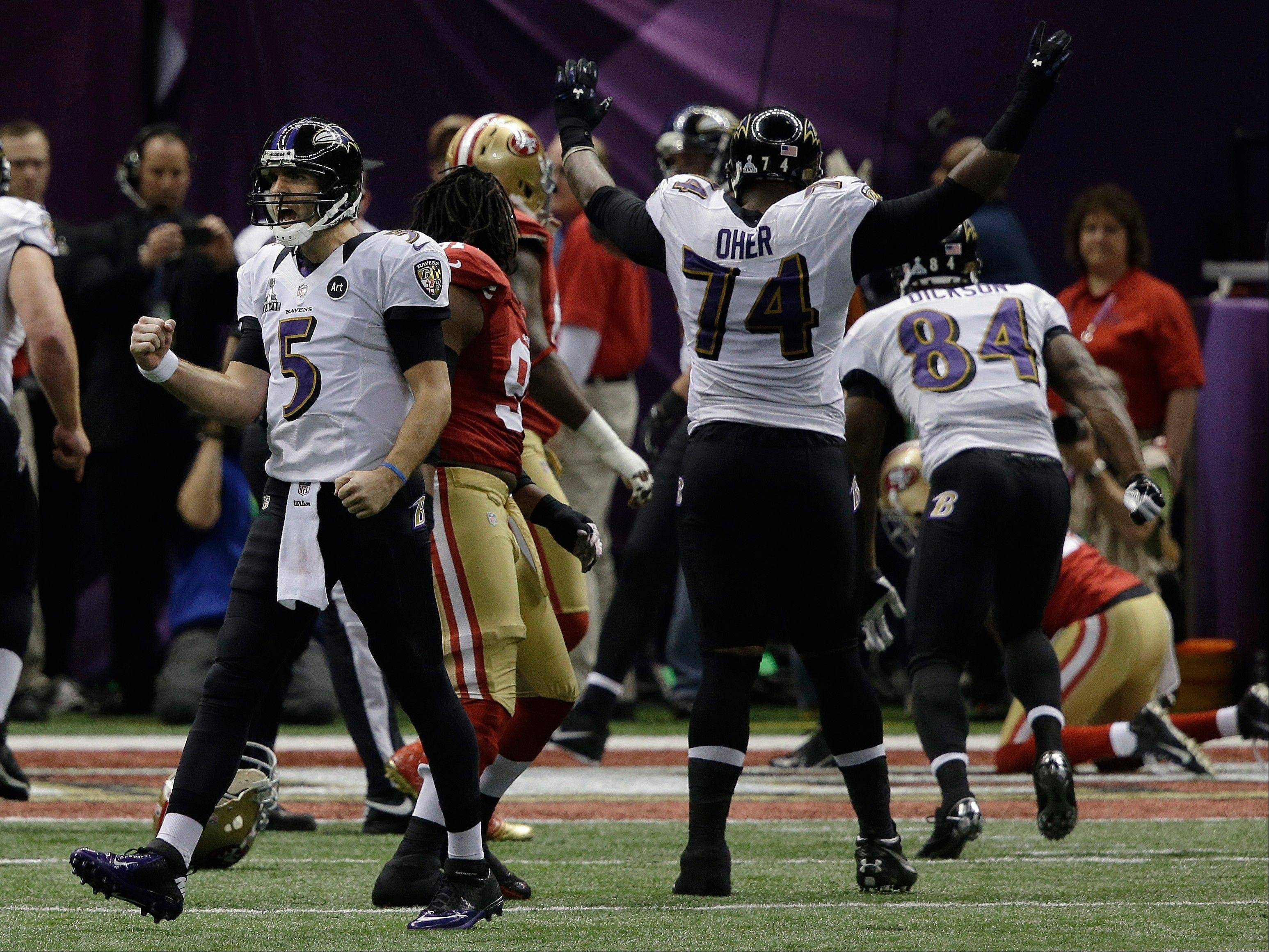 Baltimore Ravens quarterback Joe Flacco (5) reacts after throwing a 1-yard touchdown pass to tight end Dennis Pitta against the San Francisco 49ers during the first half.