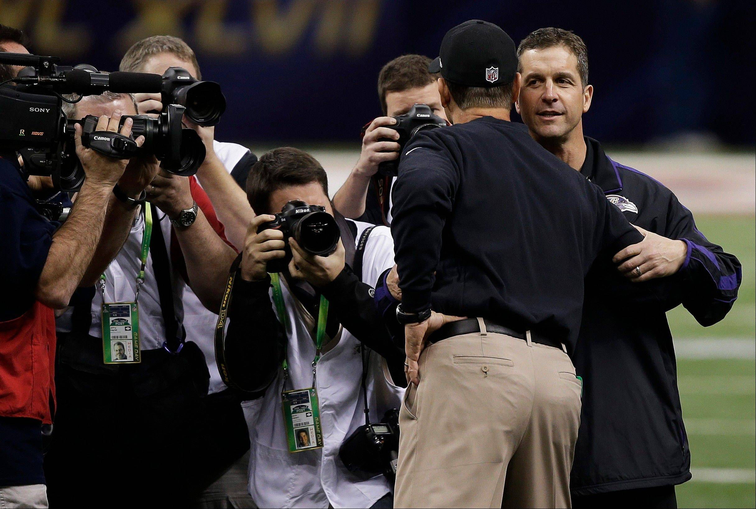 San Francisco 49ers head coach Jim Harbaugh, left, embraces his brother Baltimore Ravens head coach John Harbaugh before the NFL Super Bowl XLVII football game.