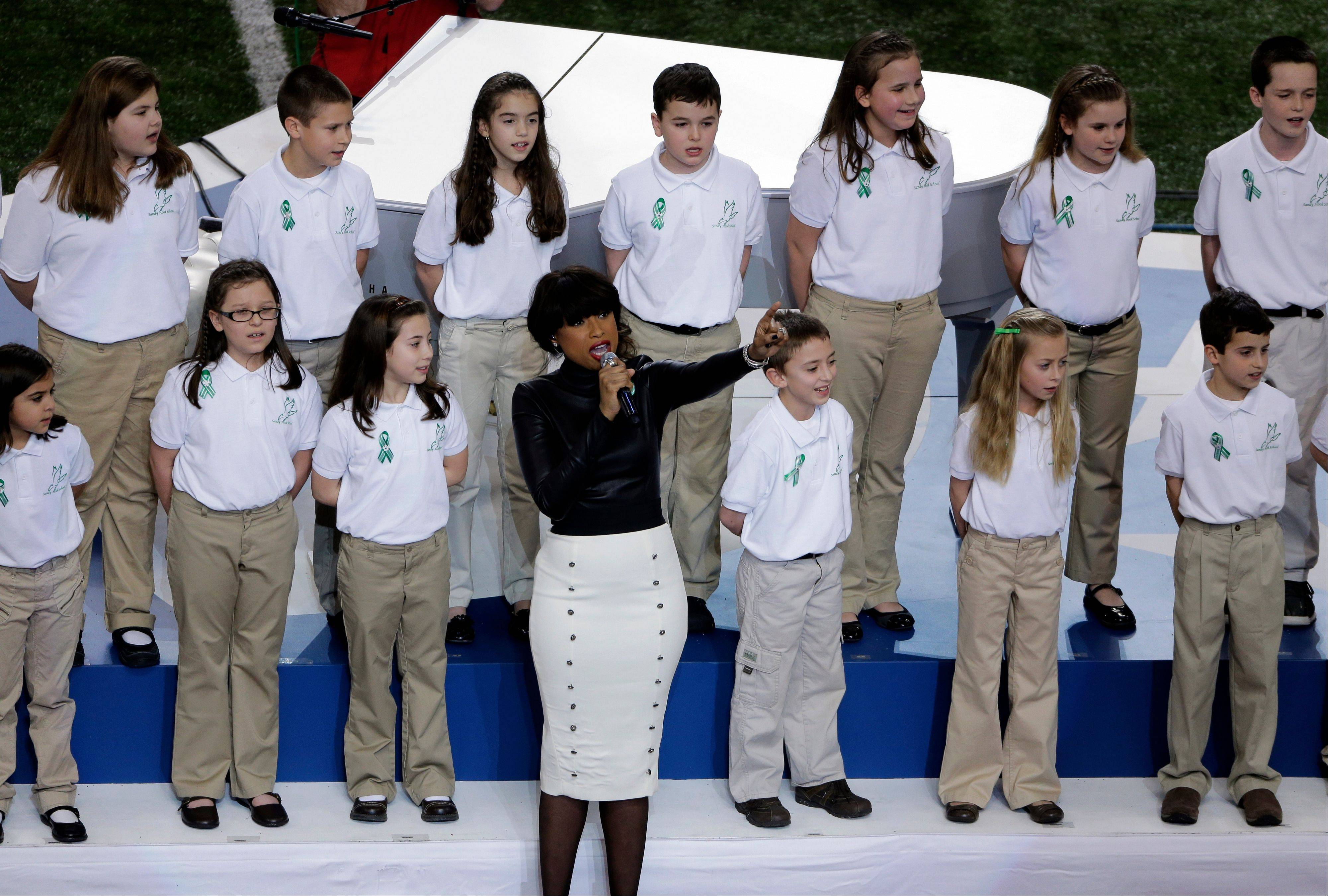 "Jennifer Hudson performs with students from Sandy Hook Elementary School singing ""America the Beautiful"" before the NFL Super Bowl XLVII football game between the San Francisco 49ers and the Baltimore Ravens."
