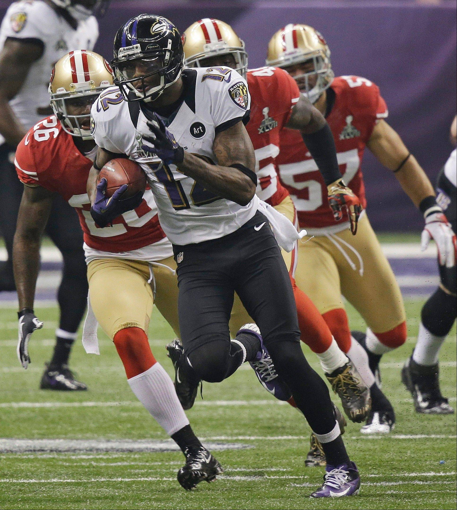 Baltimore Ravens' Jacoby Jones (12) returns a kickoff for a 109-yard touchdown against the San Francisco 49ers during the second half.