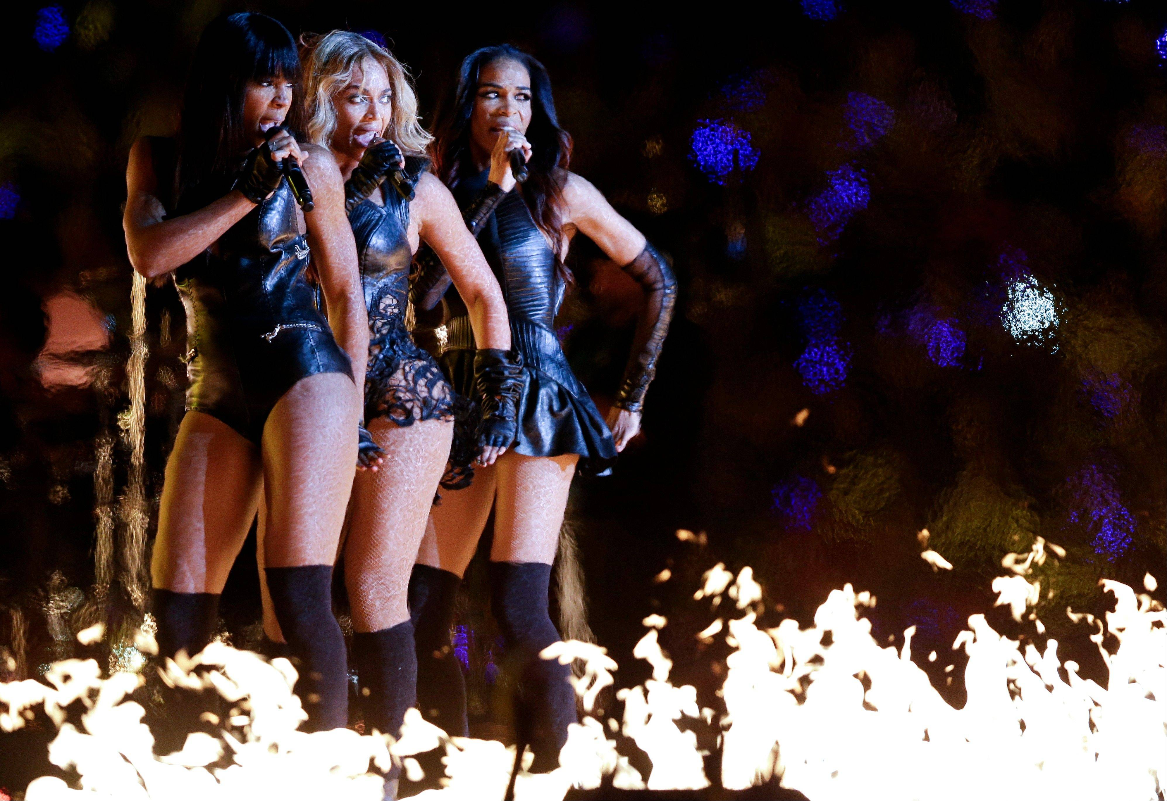 Beyonc�, center, Kelly Rowland, left, and Michelle Williams, of Destiny's Child, perform during the halftime show of the NFL Super Bowl XLVII football game.