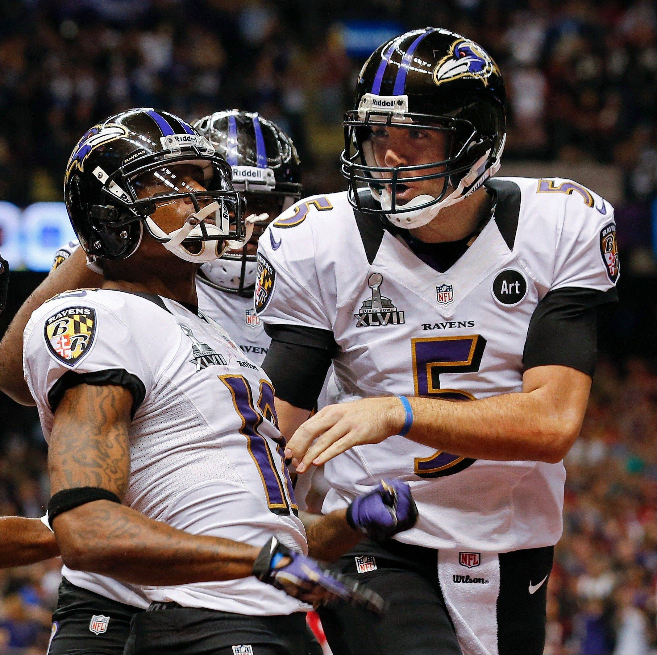 Baltimore Ravens quarterback Joe Flacco (5) congratulates wide receiver Jacoby Jones (12) after Jones caught a touchdown pass in the second quarter.