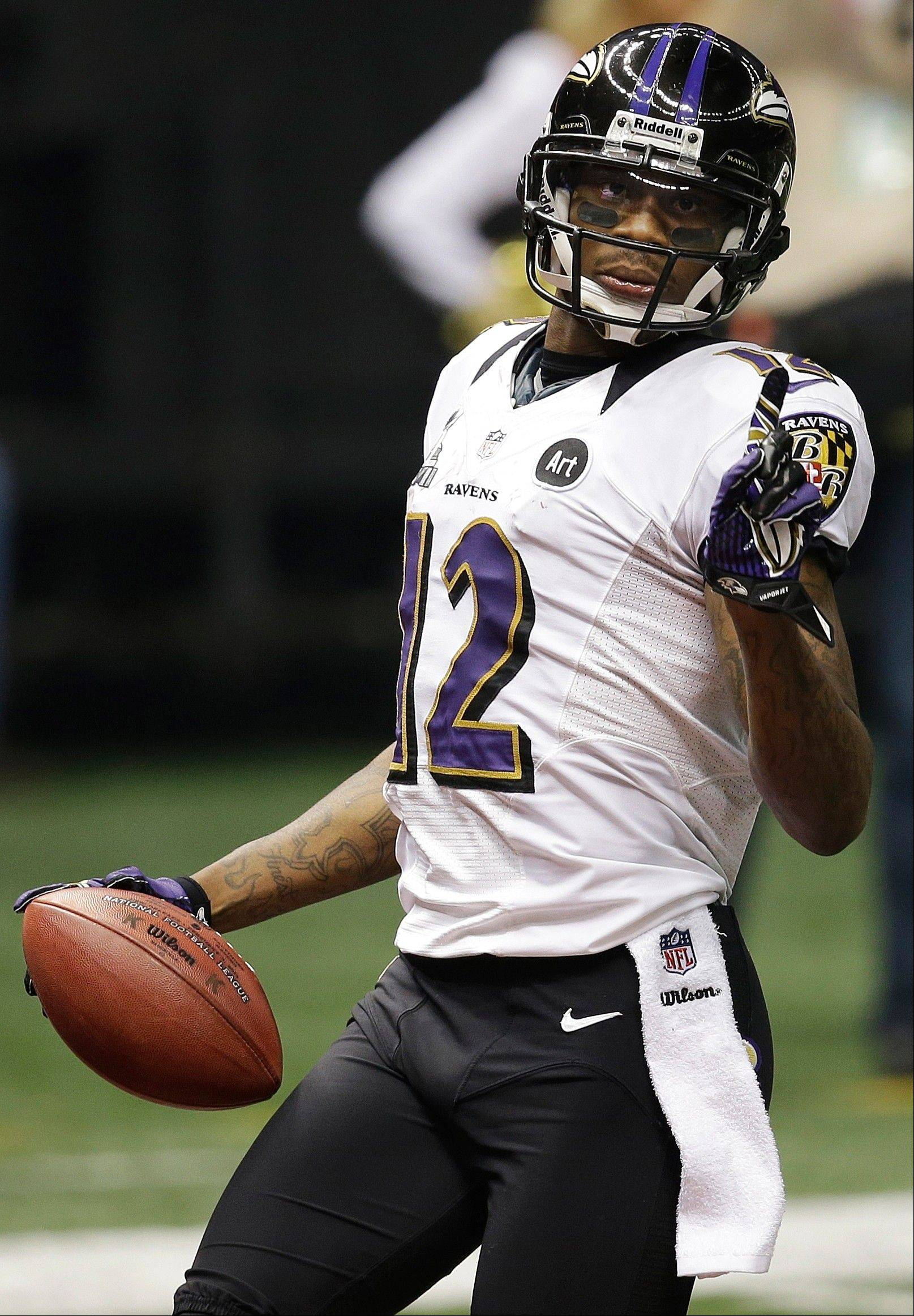 Baltimore Ravens wide receiver Jacoby Jones (12) gestures after returning a kickoff for a 109-yard touchdown against the San Francisco 49ers during the second half.