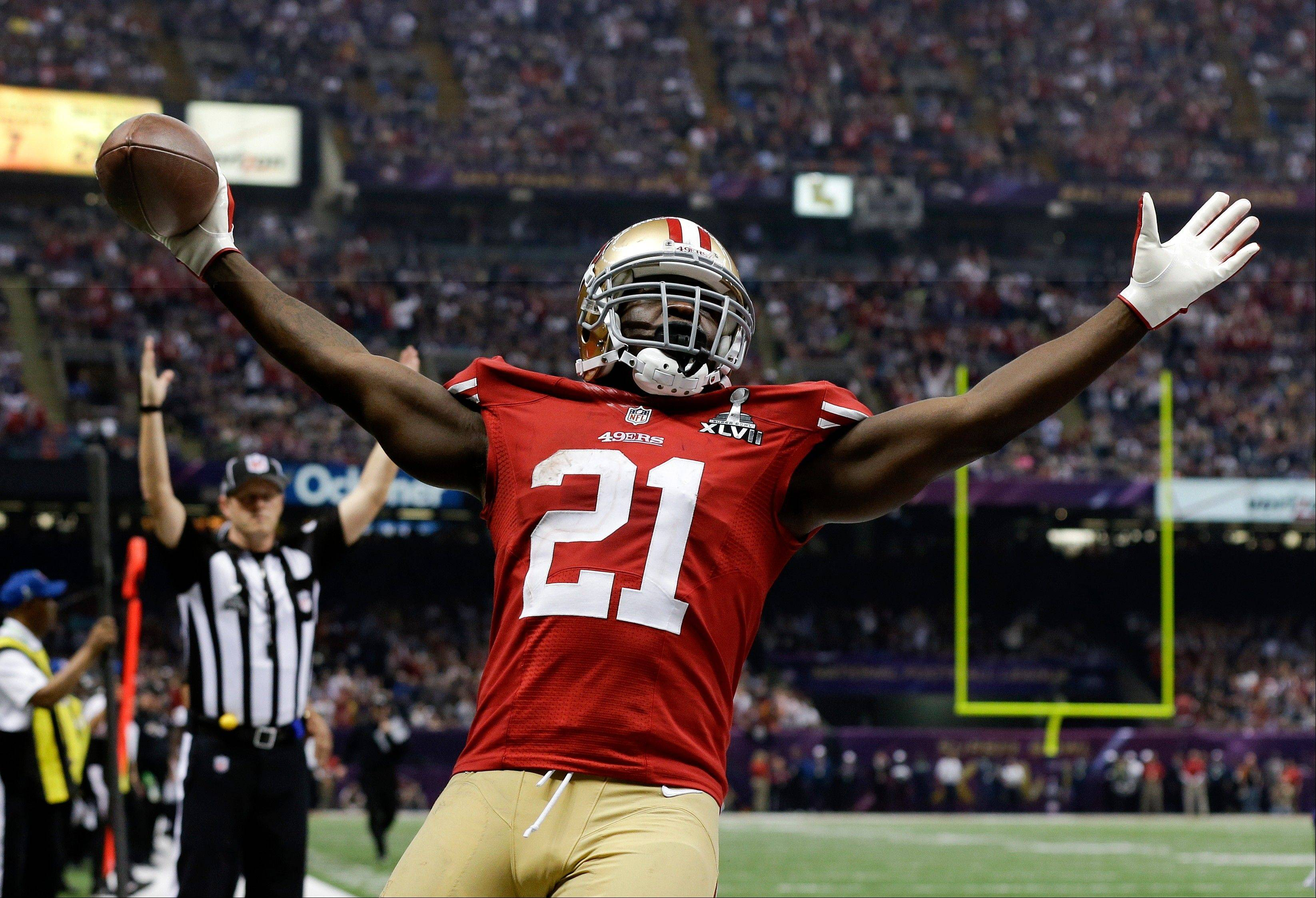 San Francisco 49ers running back Frank Gore celebrates his touchdown against the Baltimore Ravens during the second half.