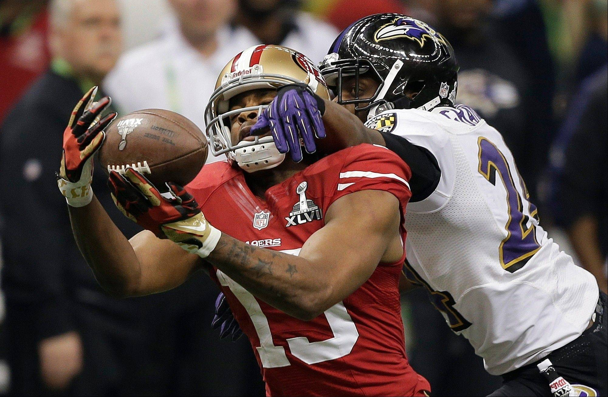Baltimore Ravens cornerback Corey Graham (24) breaks up a pass intended for San Francisco 49ers wide receiver Michael Crabtree (15) during the second half.