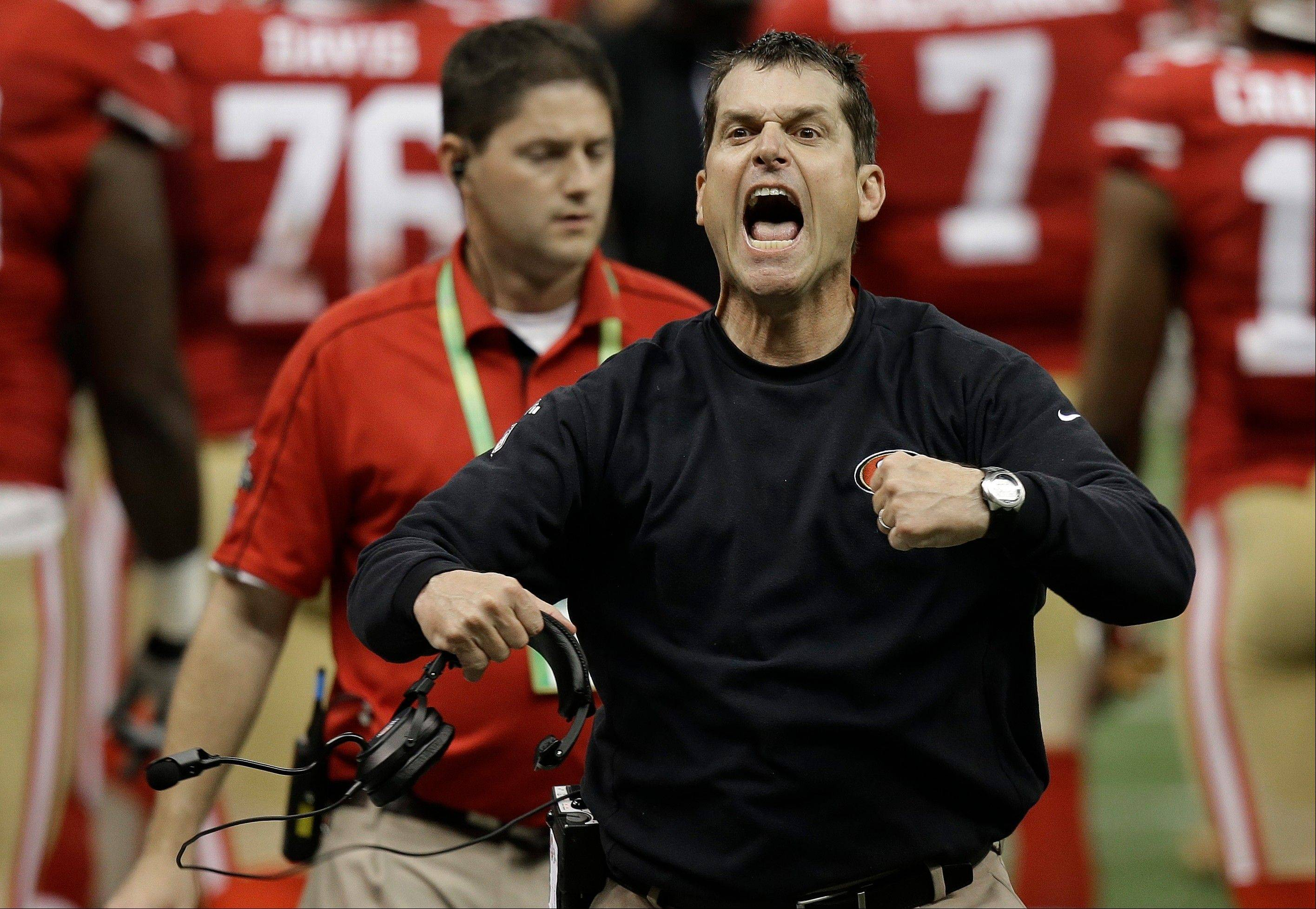 San Francisco 49ers head coach Jim Harbaugh protests a non-call by the officials after a fourth down play against the Baltimore Ravens during the second half.