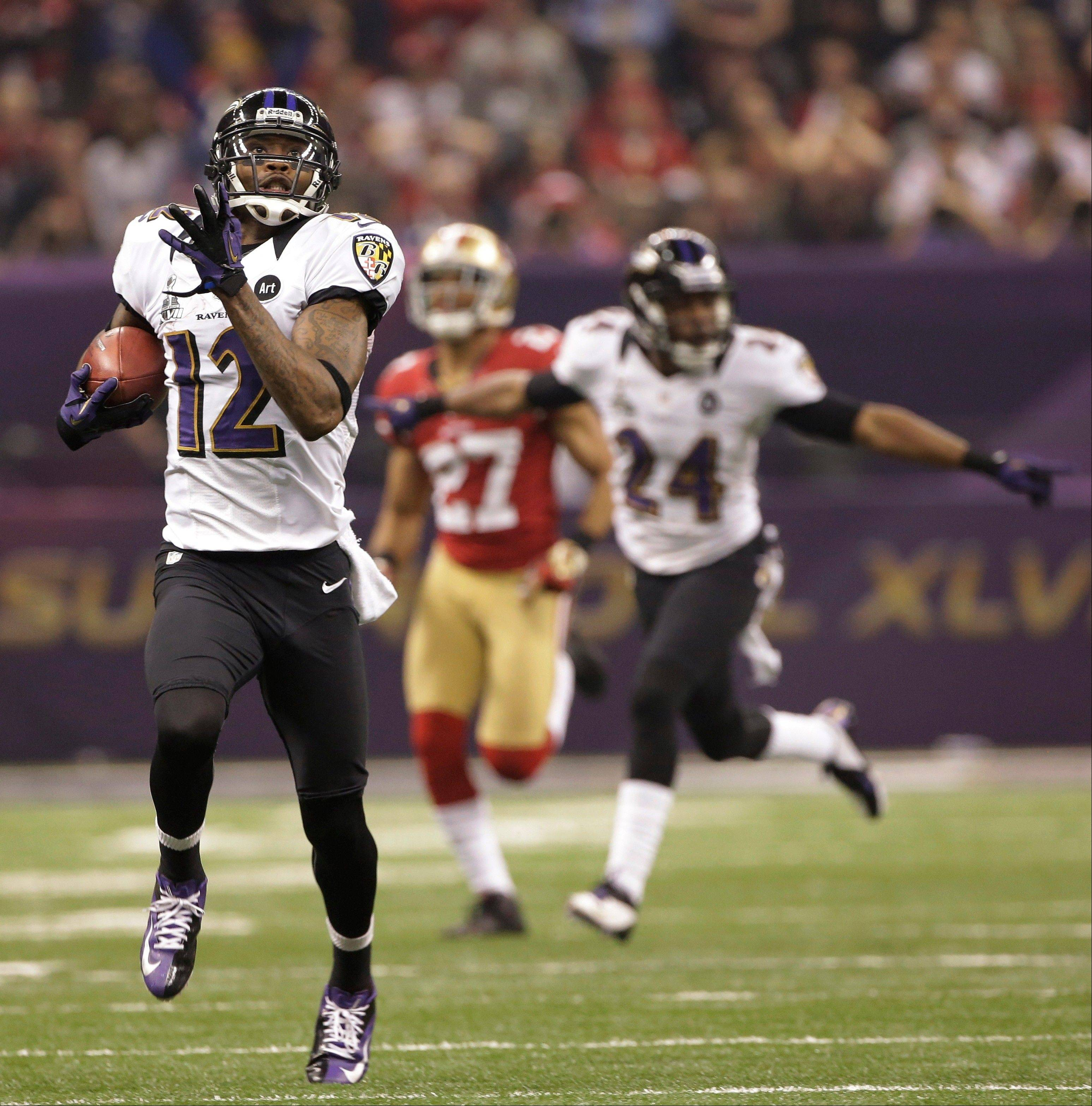 Baltimore Ravens wide receiver Jacoby Jones (12) runs for a touchdown during the second half.