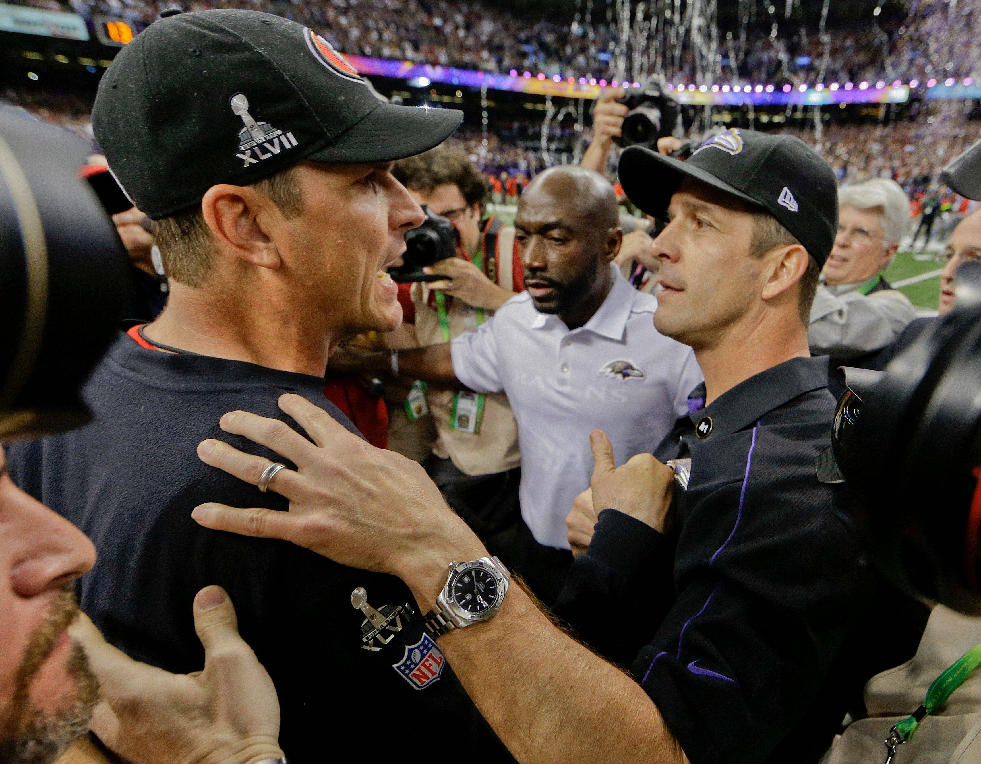 San Francisco 49ers head coach Jim Harbaugh, left, greets Baltimore Ravens head coach John Harbaugh after the Ravens defeated the 49ers 34-31 in the NFL Super Bowl XLVII football game.
