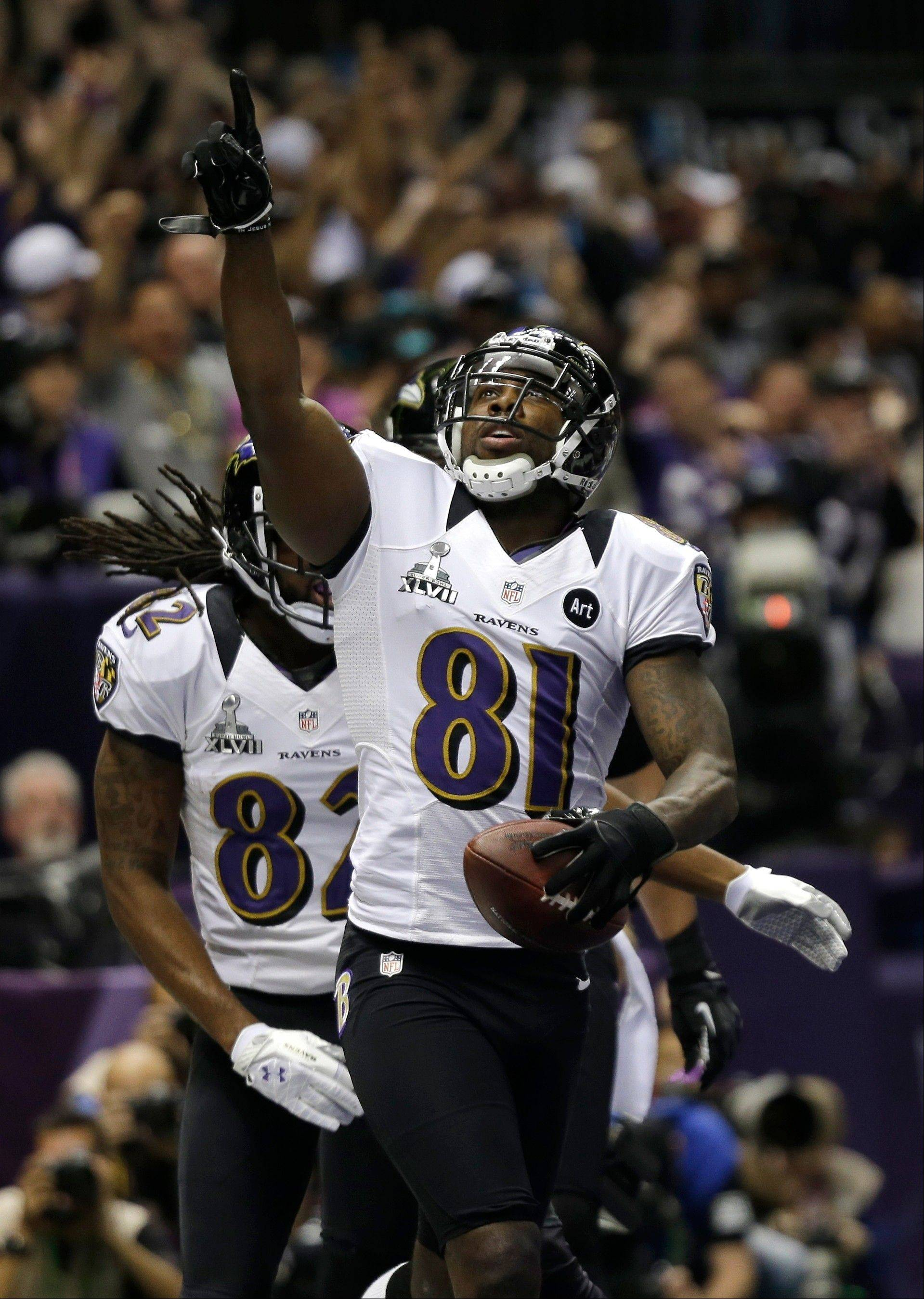 Baltimore Ravens wide receiver Anquan Boldin (81) reacts after catching a 13-yard touchdown pass during the first half.