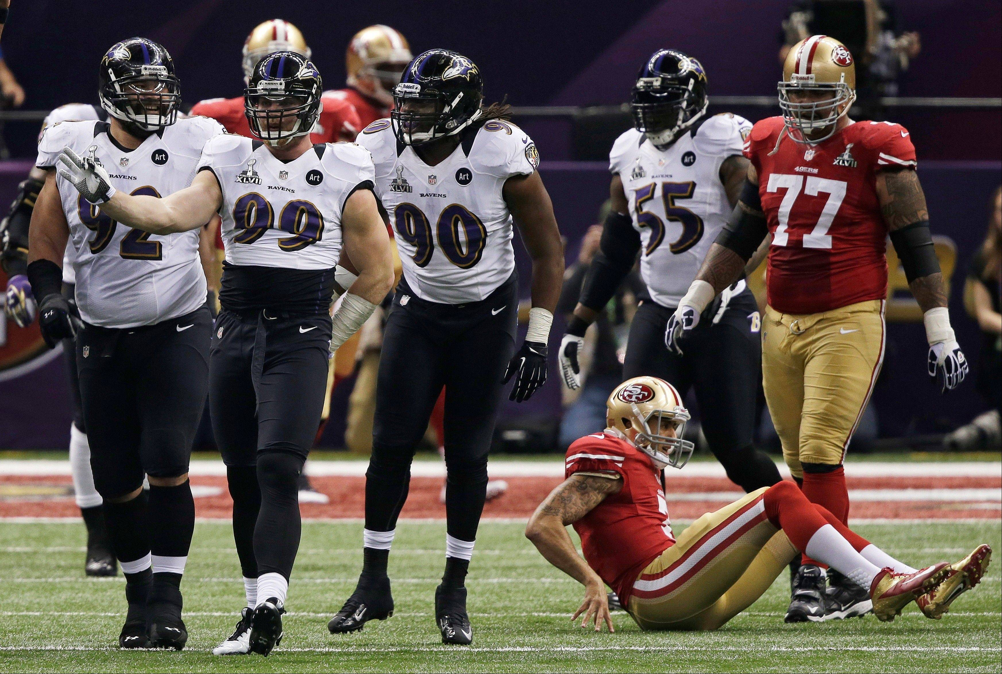 Baltimore Ravens linebacker Paul Kruger (99) reacts after sacking San Francisco 49ers quarterback Colin Kaepernick (7) during the first half.