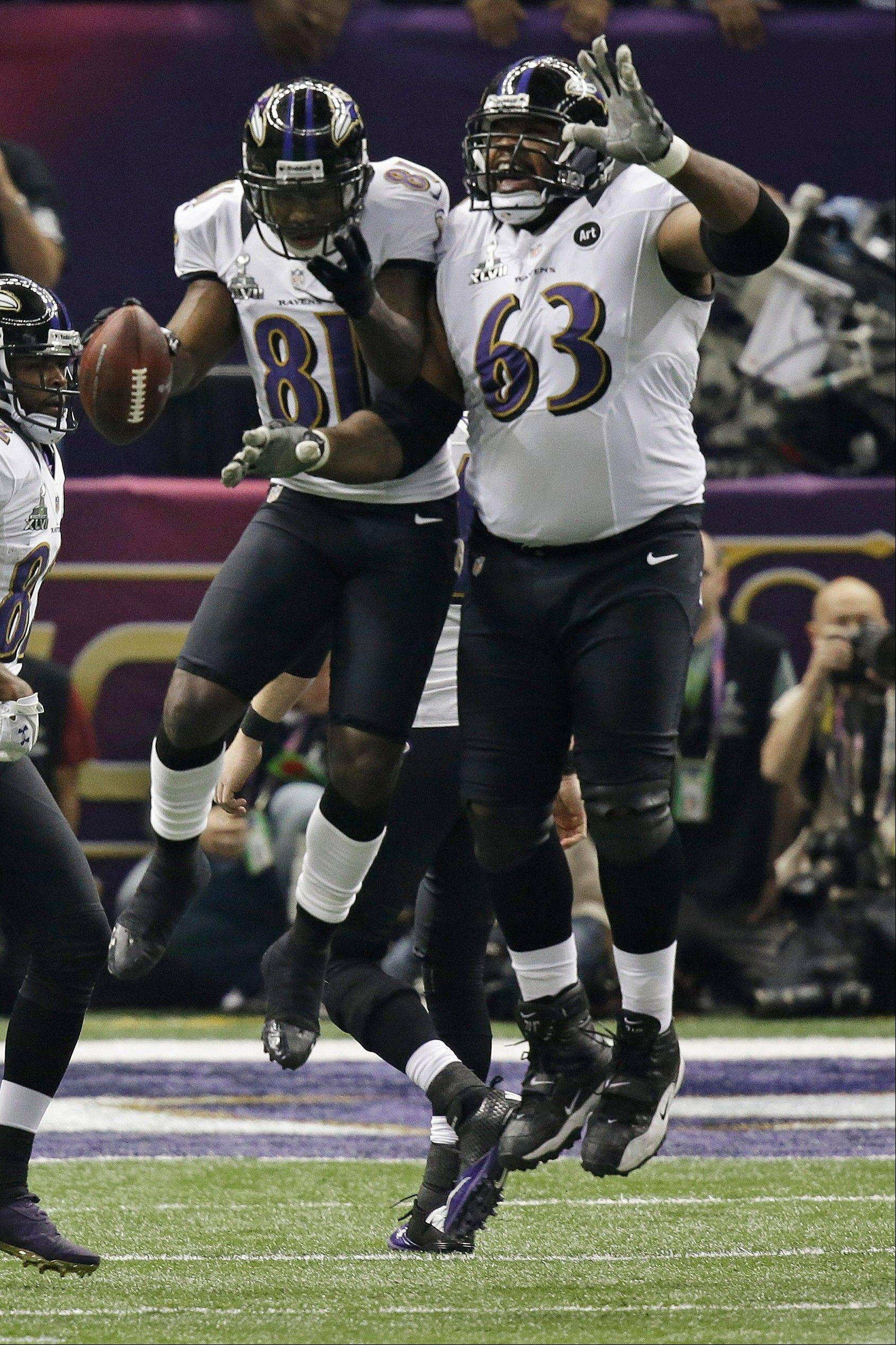 Baltimore Ravens wide receiver Anquan Boldin (81) celebrate his touchdown reception with offensive lineman Bobbie Williams (63) in the first half.
