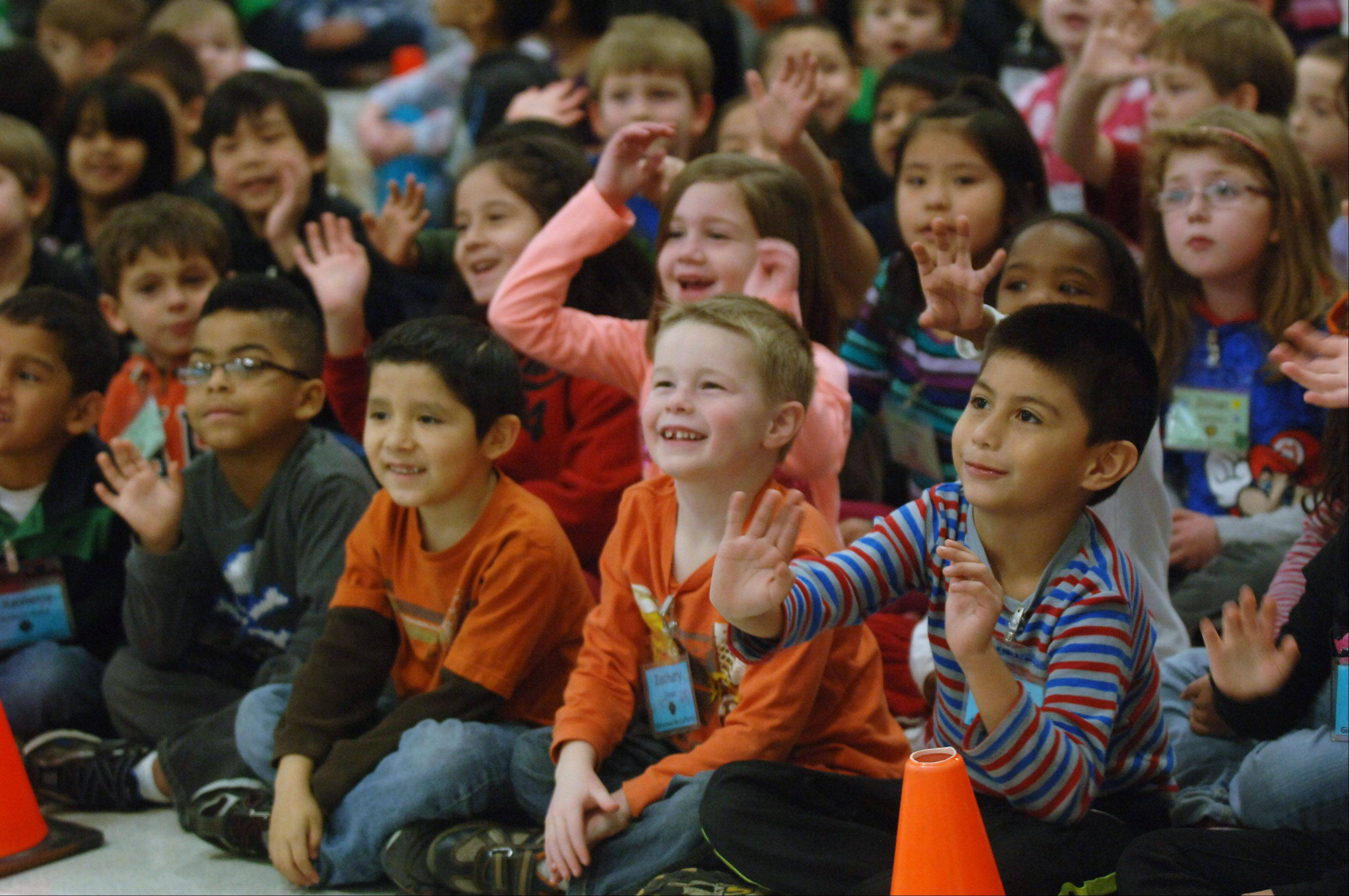 Woodland Primary School�s kindergarten students in Gages Lake watch the Jumpers on Fire team from Loves Park.