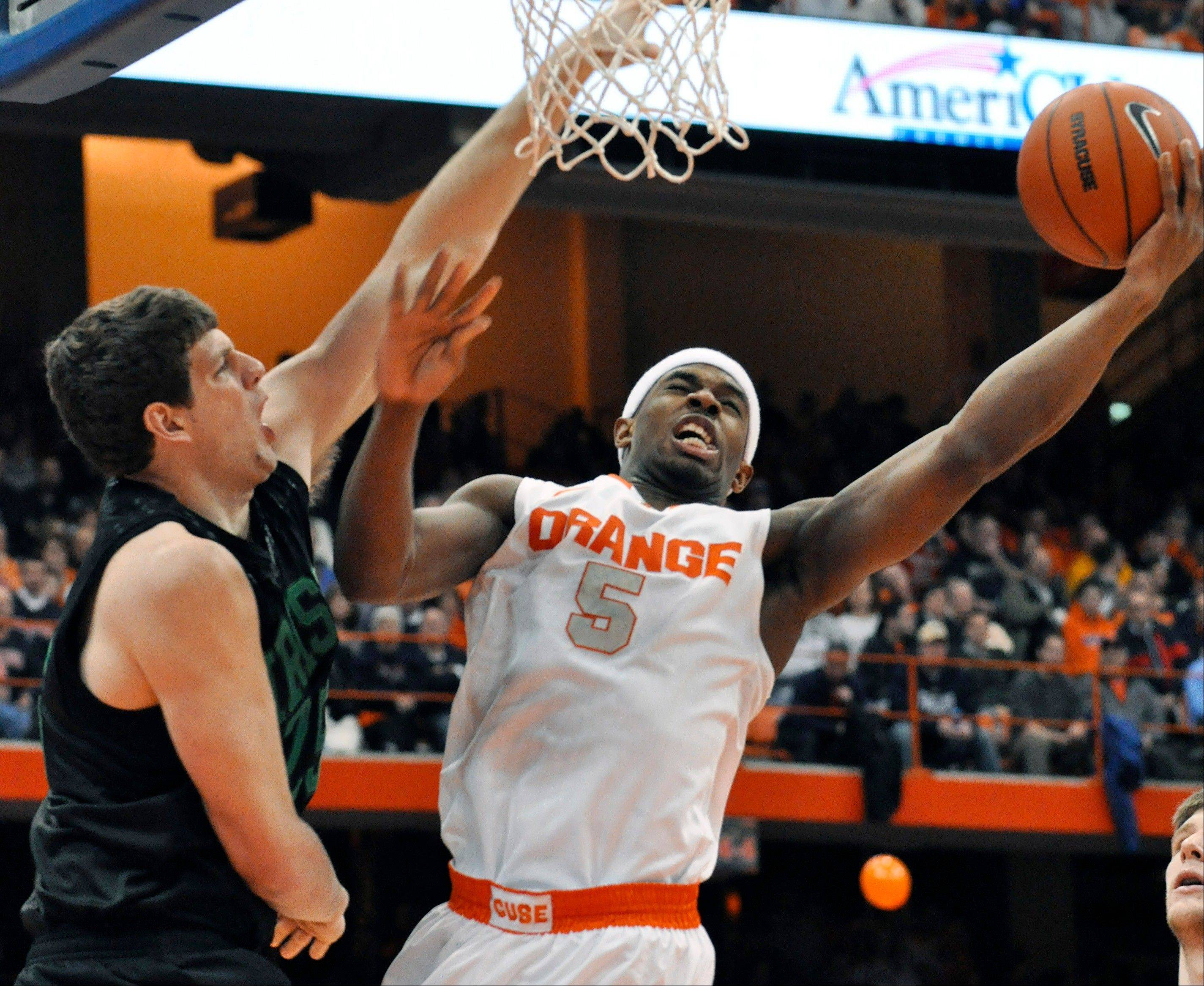 Syracuse�s C.J. Fair scores against Notre Dame�s Tom Knight during the second half of Monday�s game in Syracuse, N.Y.