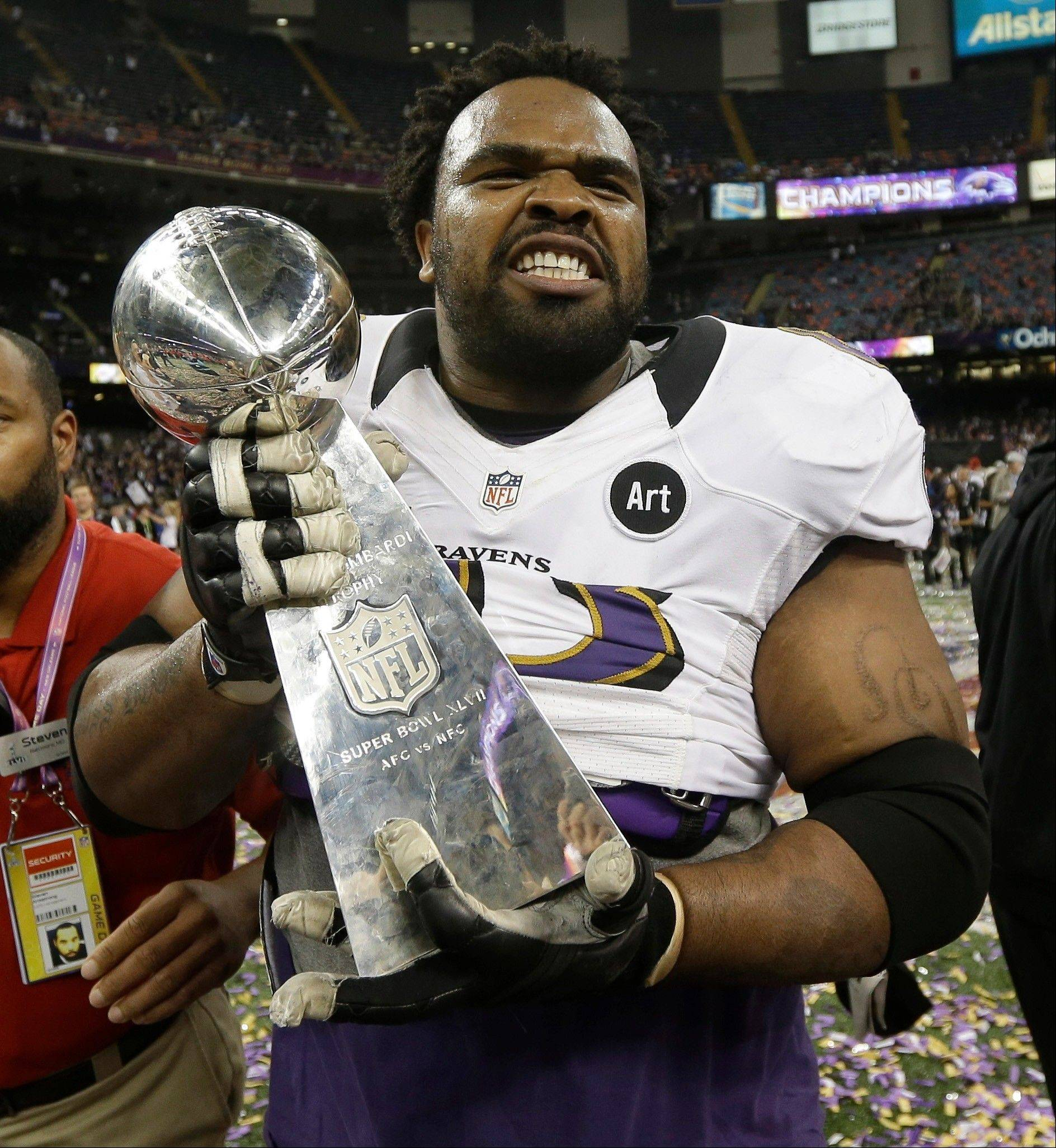 Baltimore Ravens offensive lineman Bobbie Williams walks off the field with the Vince Lombardi Trophy after their 34-31 win against the San Francisco 49ers in the NFL Super Bowl XLVII football game Sunday in New Orleans.