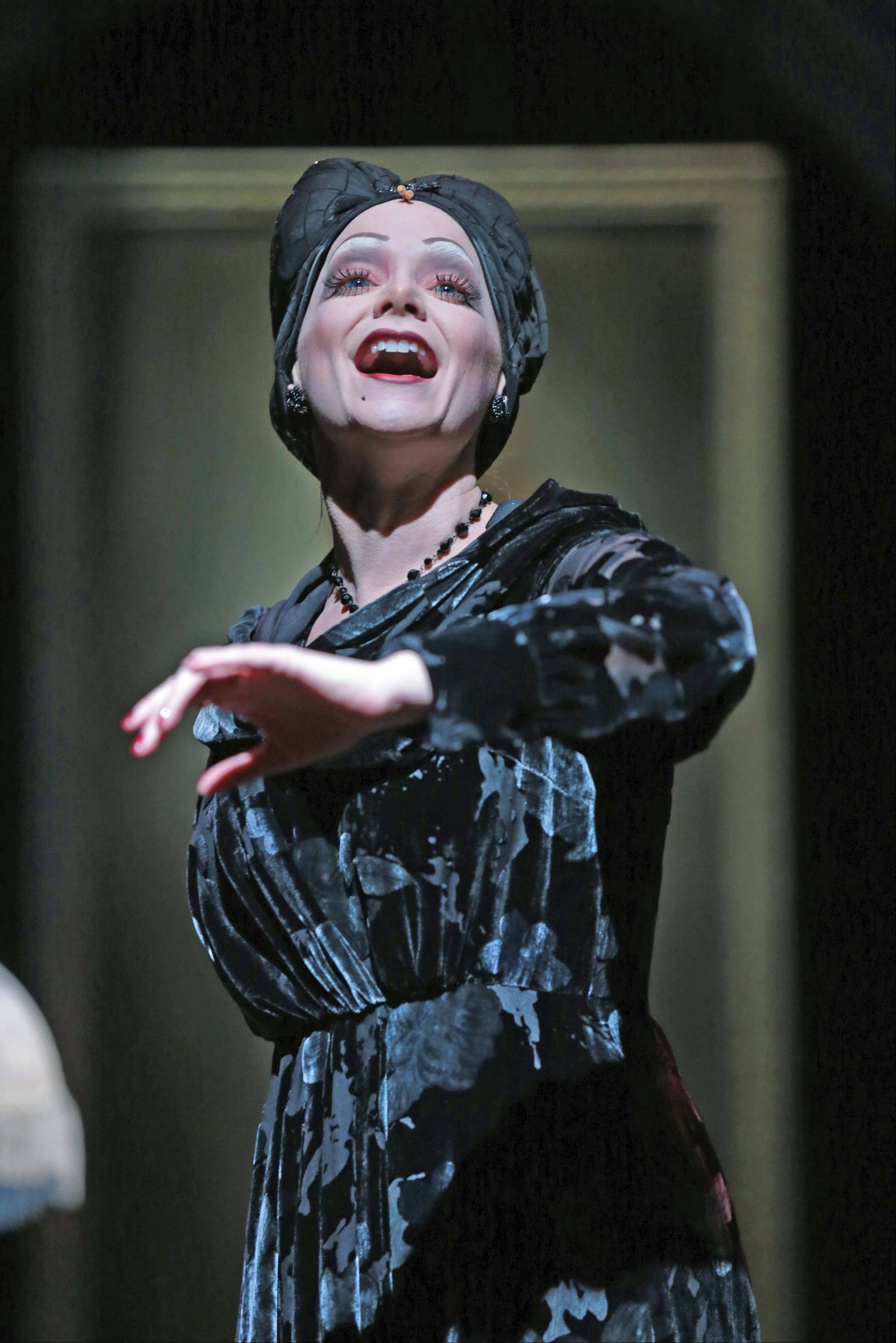 "Faded movie star Norma Desmond (Christine Sherrill) sings of the glory days of silent cinema in ""Sunset Boulevard"" at Drury Lane Theatre in Oakbrook Terrace. The seven-time Tony Award-winning Andrew Lloyd Webber musical continues through Sunday, March 24."