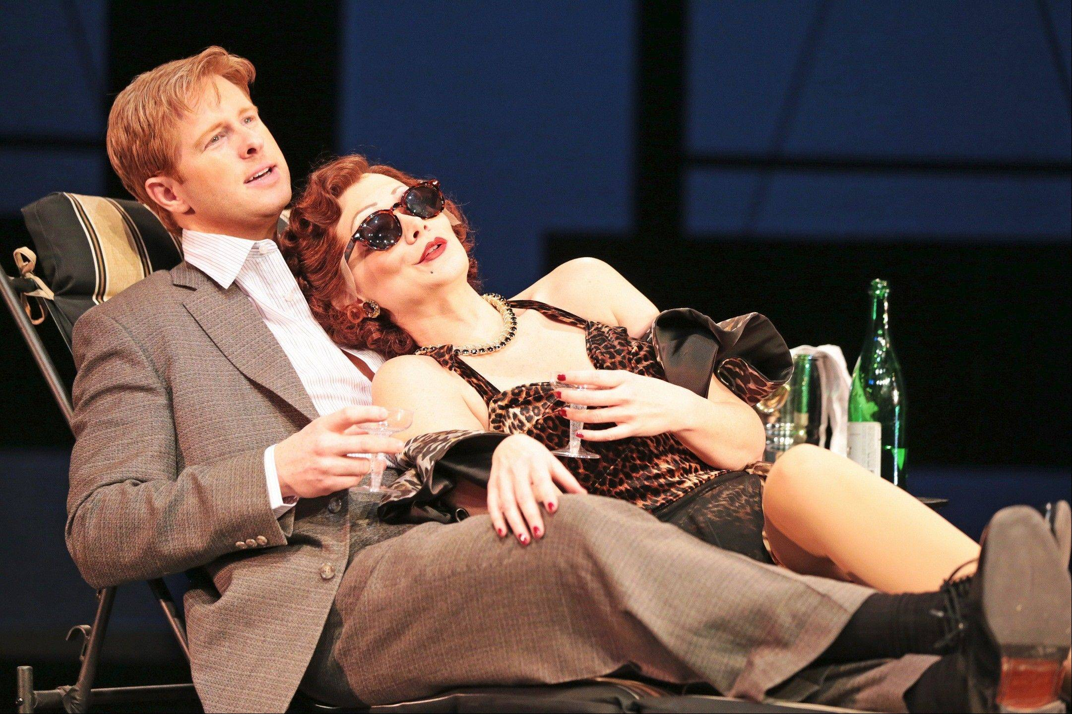 "Faded movie star Norma Desmond (Christine Sherrill, right) clings to her reluctant boy toy and screenwriter Joe Gillis (Will Ray) in ""Sunset Boulevard"" at Drury Lane Theatre in Oakbrook Terrace. The seven-time Tony Award-winning Andrew Lloyd Webber musical continues through Sunday, March 24."
