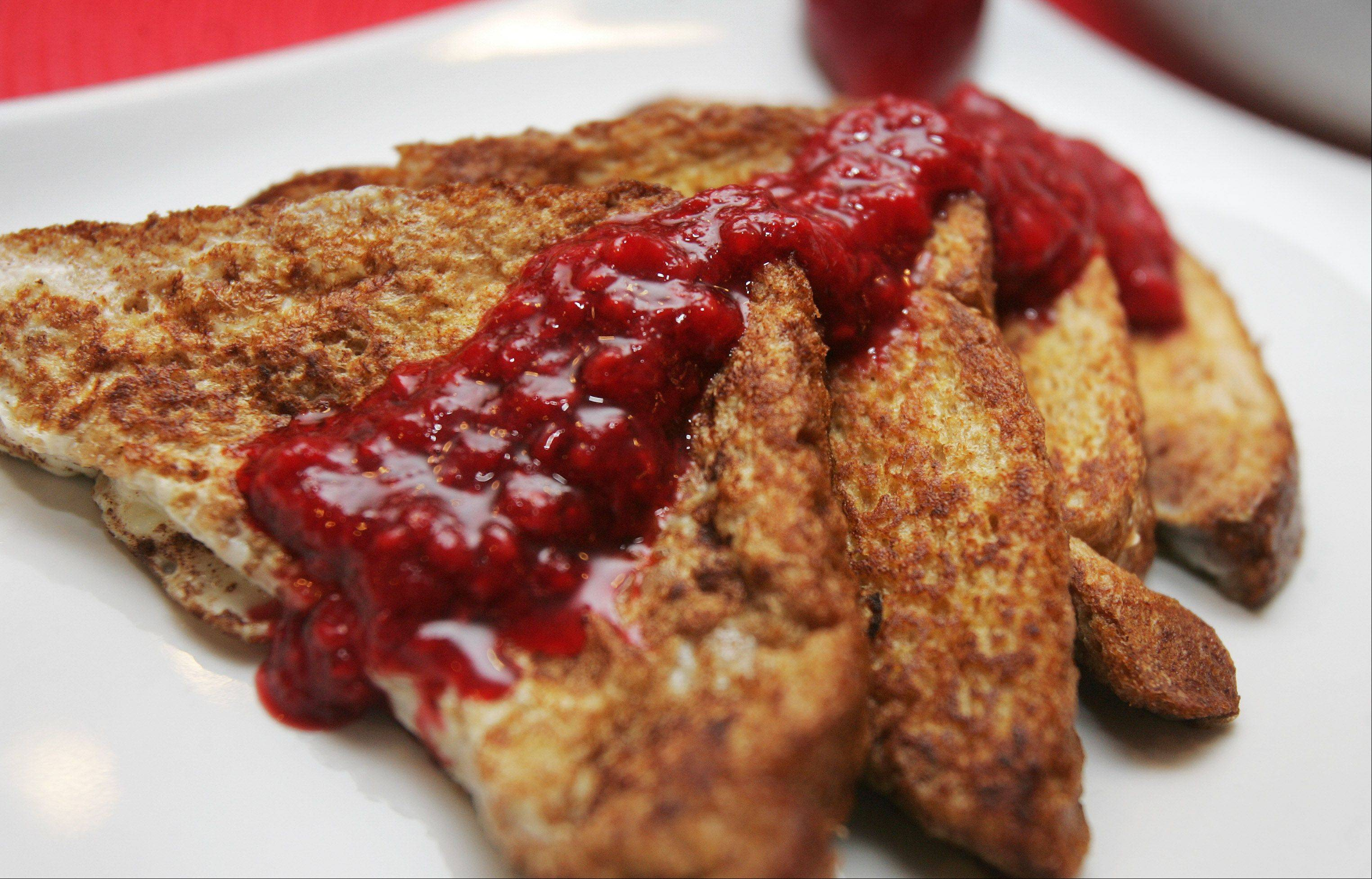Pamper your sweetheart's heart with a Valentine's Day breakfast of berry-sauced whole wheat French toast.