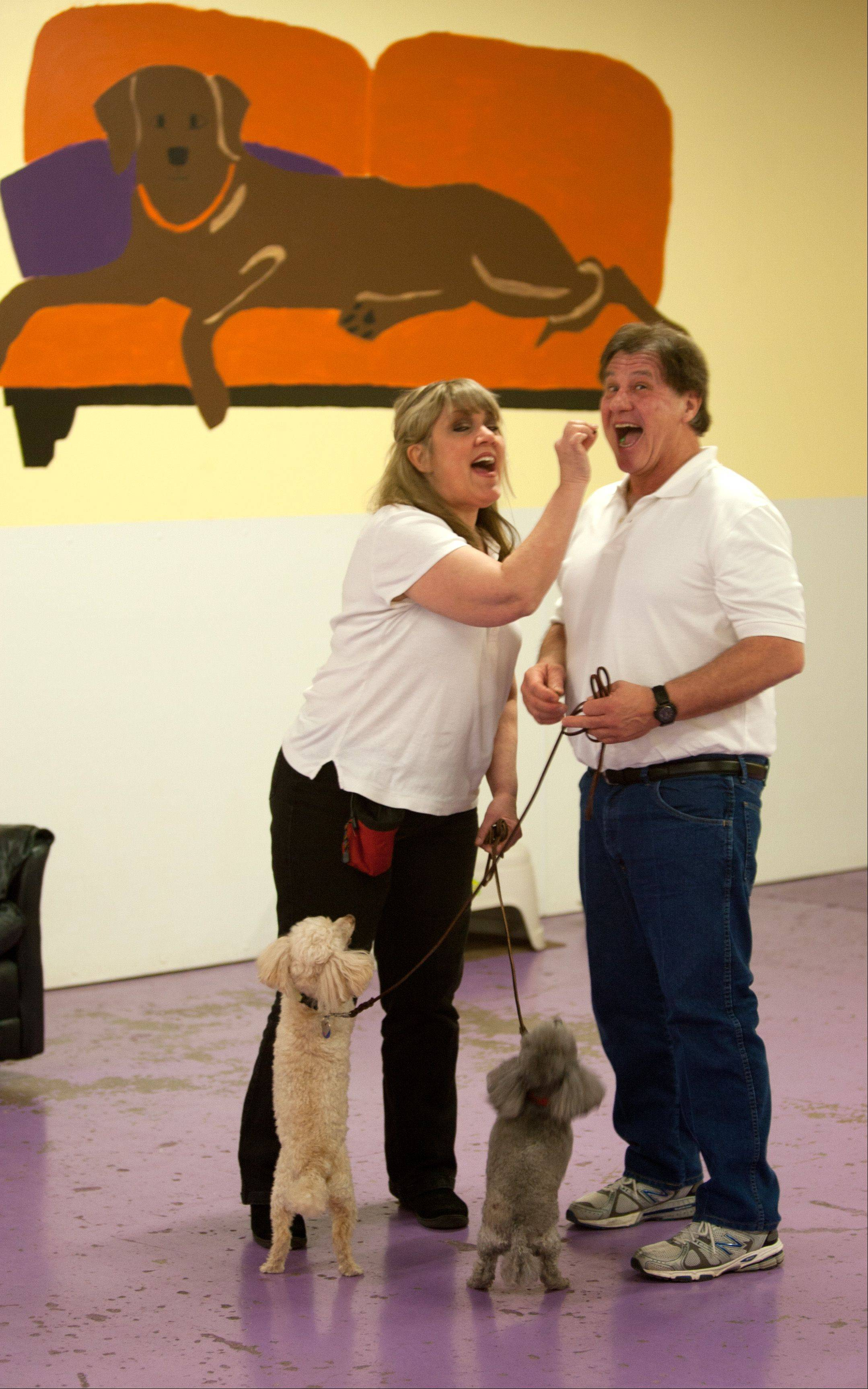 Philip and Etola Zinni, married for 32 years, share numerous activities, one of which includes spending time together at dog obedience classes with their poodles Autumn and Lexi.
