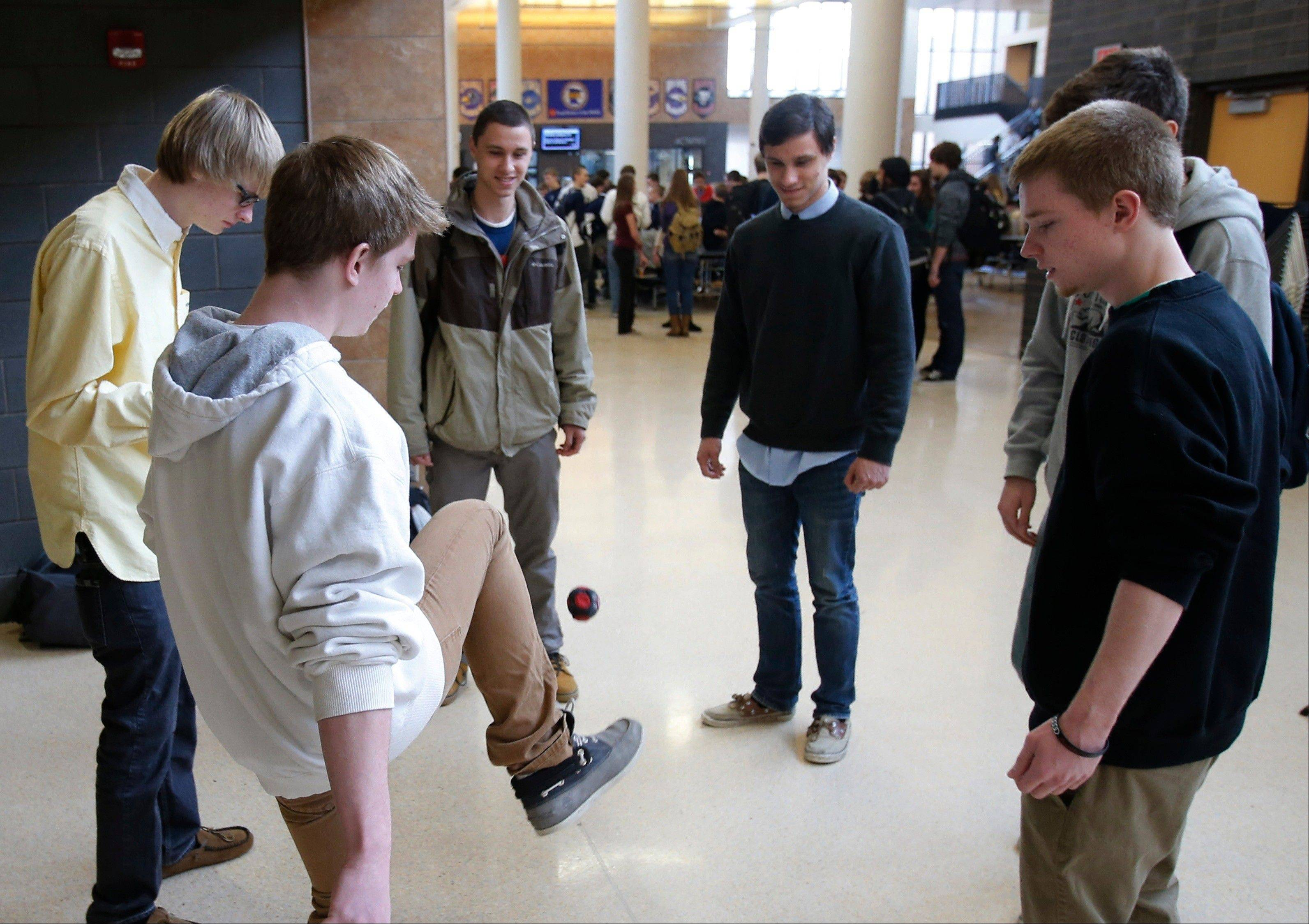 "Chanhassen High School students play a game of hackie sack and relax during their 20-minute ""recess"" in the school's theater in Chanhassen, Minn."