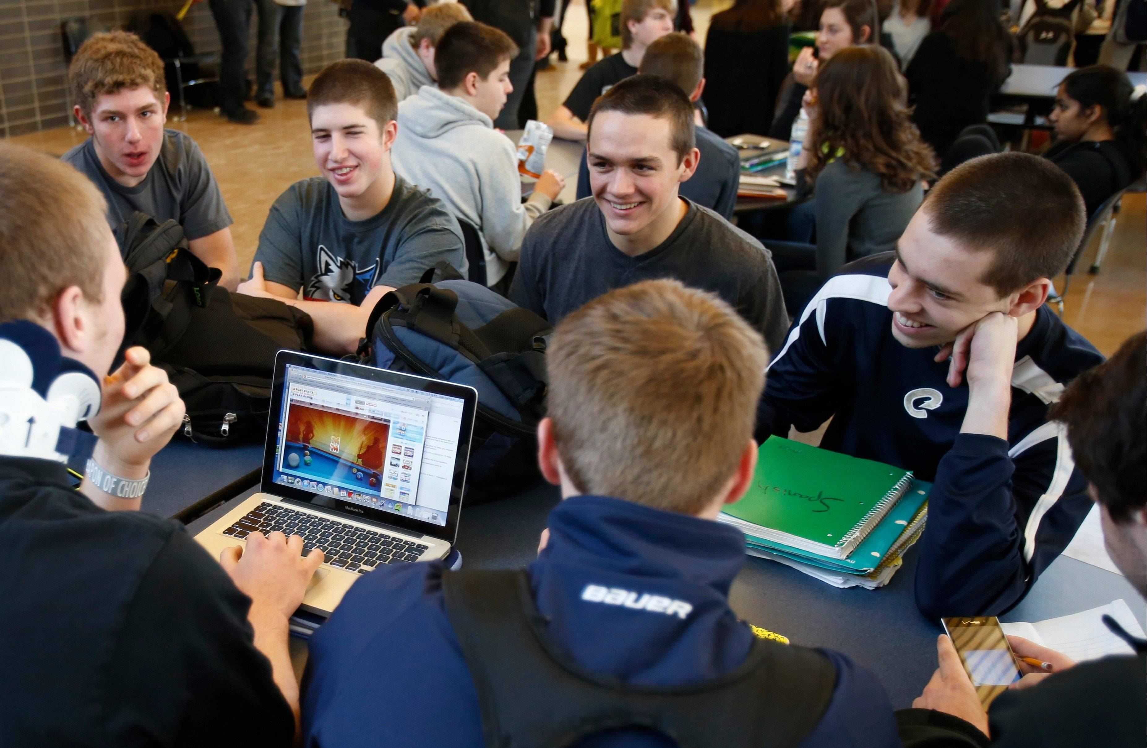 "Chanhassen High School students relax while another plays a computer game during a 20-minute ""recess"" in the cafeteria commons area during a stress break in Chanhassen, Minn."