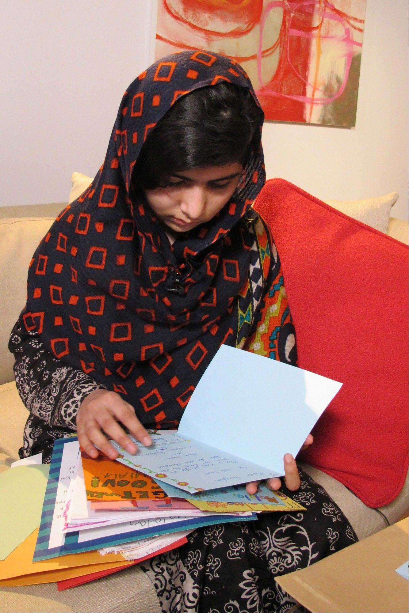 In this Jan. 22 released Monday, Malala Yousefzai reads get well cards. The Pakistani girl shot by the Taliban Oct. 9 has made her first video statement since she was nearly killed, released Monday, saying she is recovering.