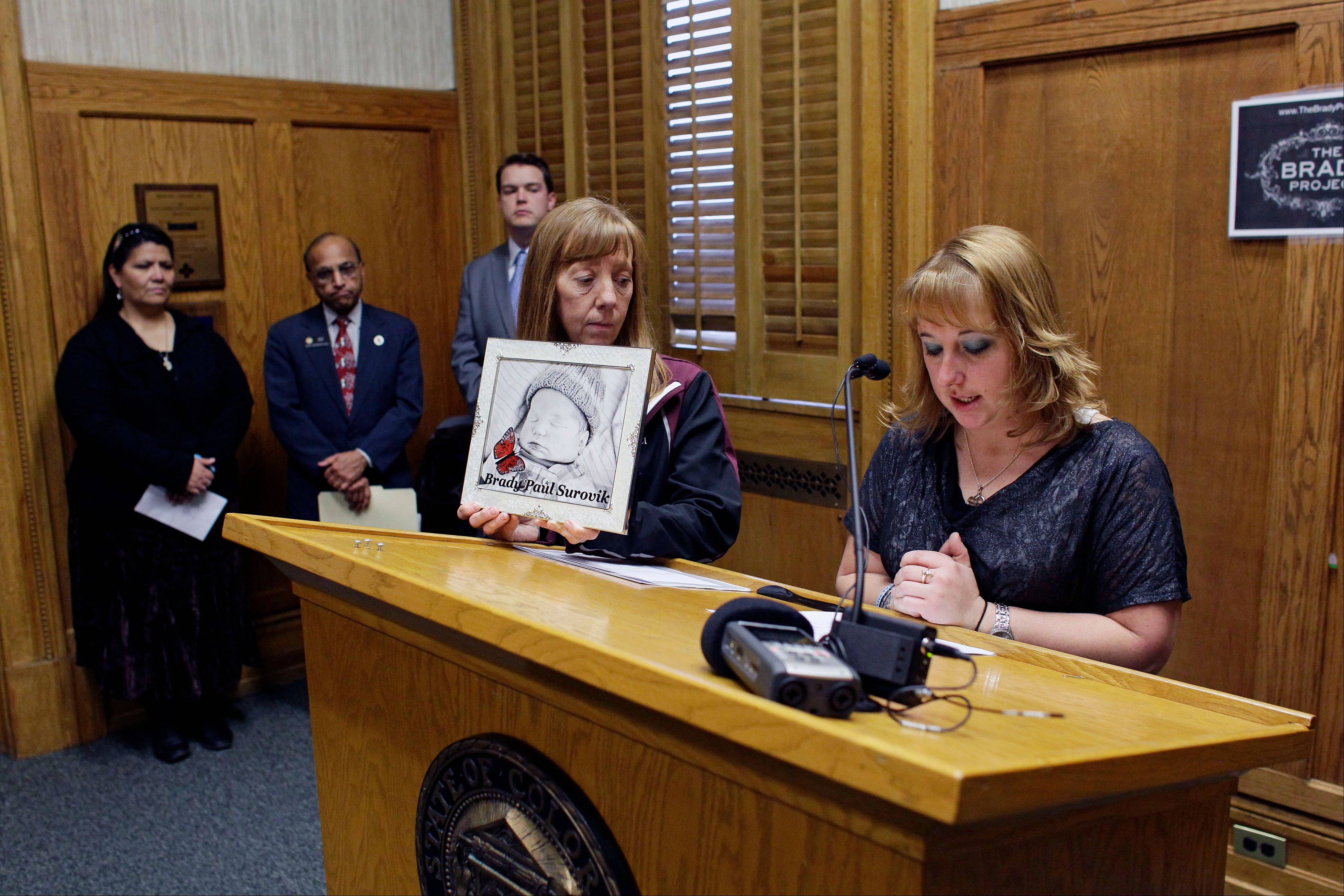 "Heather Surovik, who lost her 8�-month-old unborn son when her car was struck by drunken driver Gary Sheats in 2012, speaks at a news conference Monday, promoting a political drive to grant ""personhood"" status to unborn fetuses at the Colorado State Capitol in Denver."