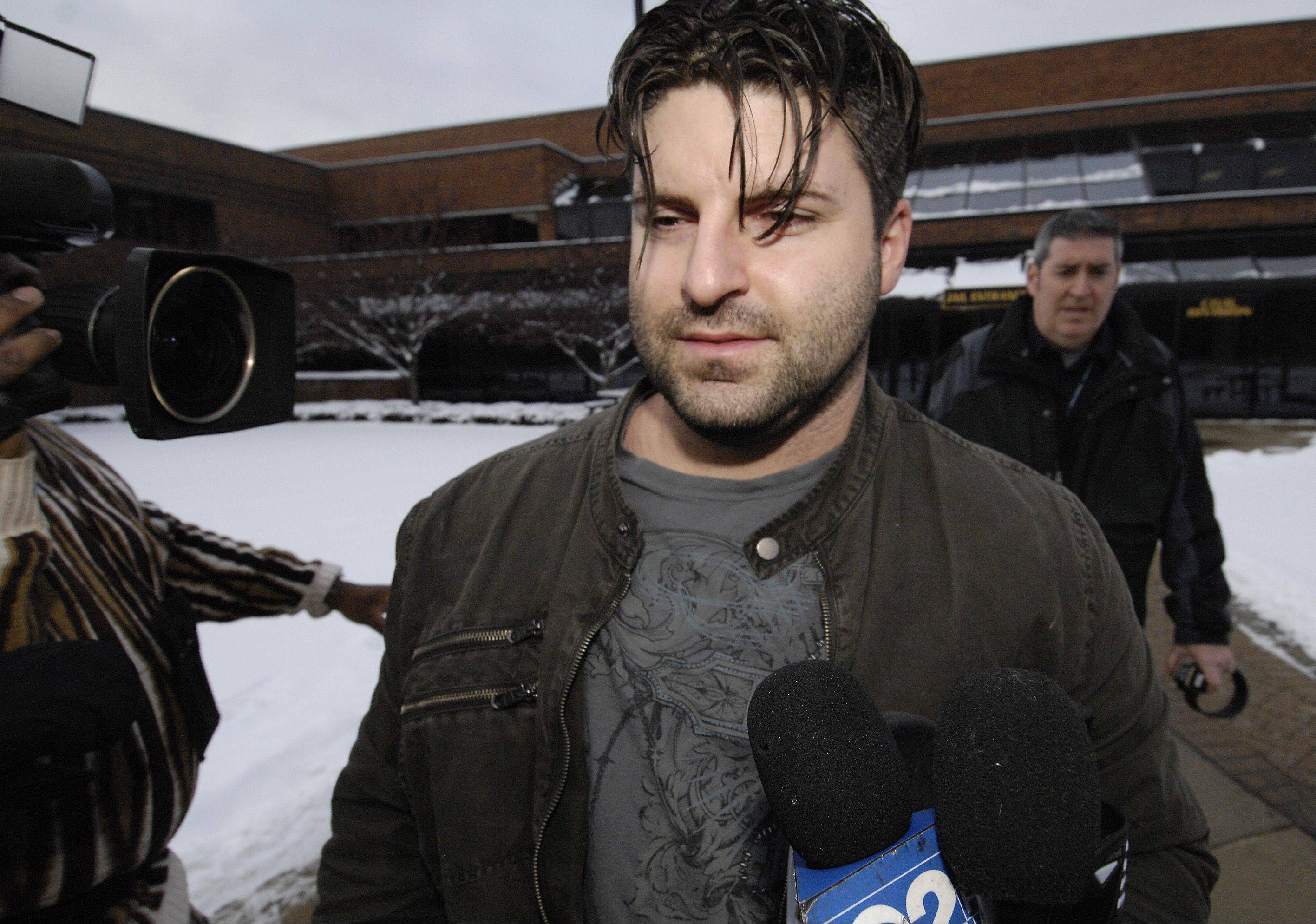 Former Schaumburg police officer Matthew Hudak leaves DuPage County jail Monday after posting $35,000 bond.