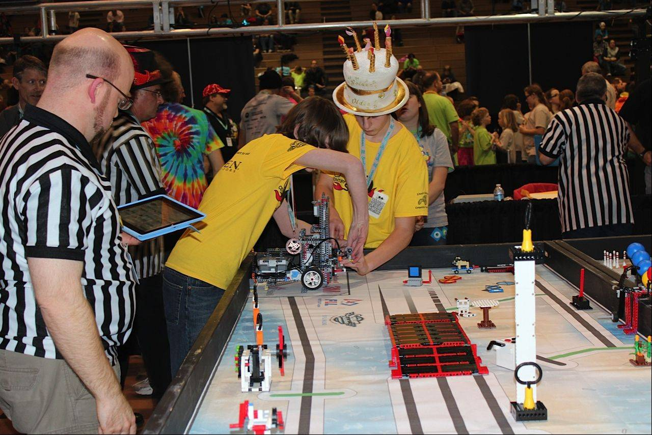 Josh Beedy and Jasper Pasternak swap attachments on the robot before sending it out on it next mission at the First Lego League state tournament last month at Forest View Educational Center in Arlington Heights.