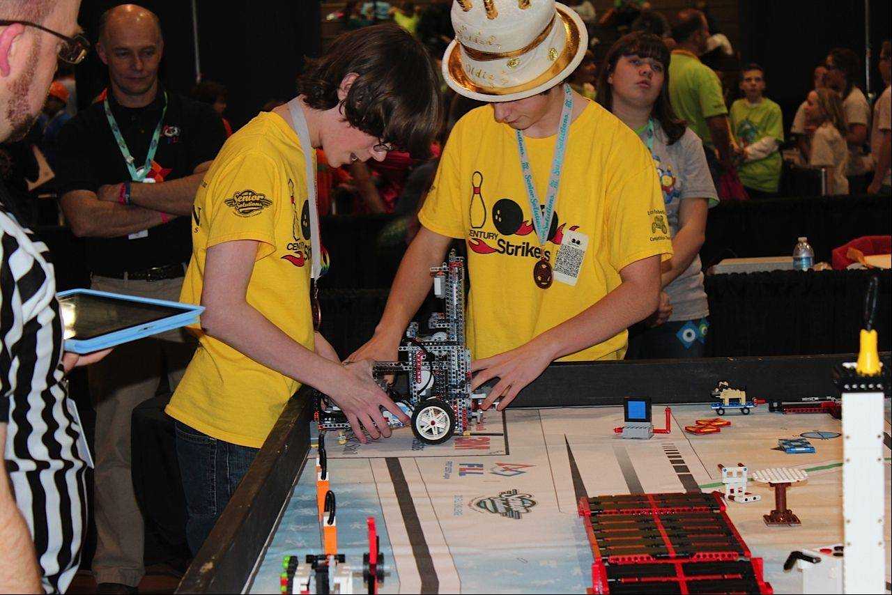 Josh Beedy and Jasper Pasternak line the robot up to complete the video calling mission during the fourth robot run of the day at the First Lego League state tournament last month at Forest View Educational Center in Arlington Heights.