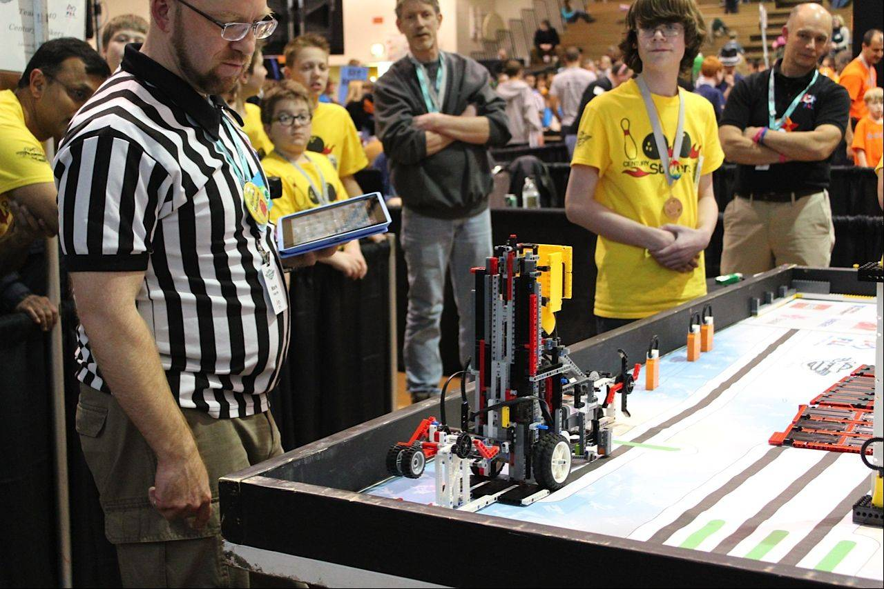 Josh Beedy watches the robot complete the weight lifting mission at the First Lego League state tournament last month at Forest View Educational Center in Arlington Heights.