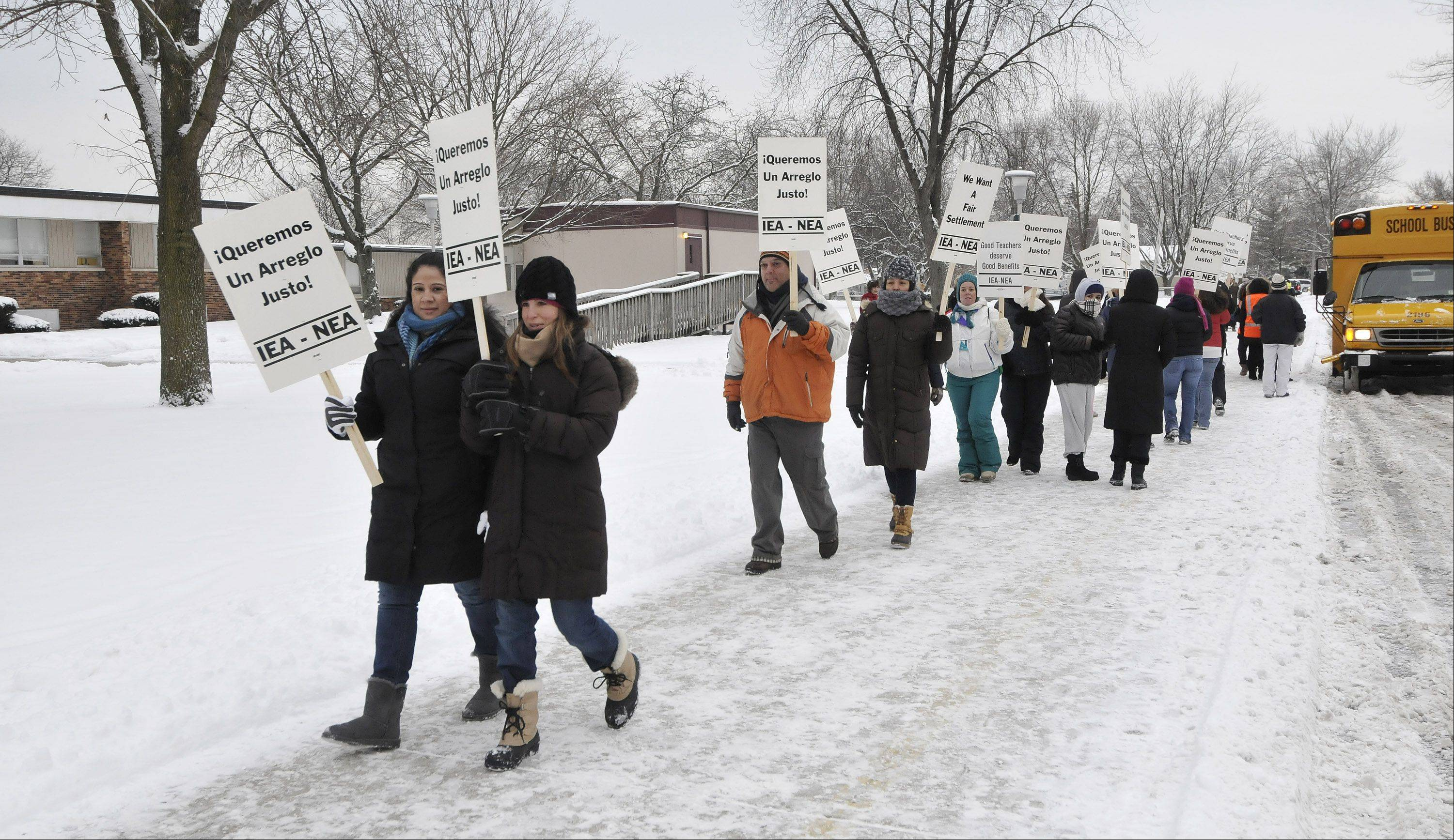 Teachers in West Chicago Elementary District 33 were on picket lines Monday at schools throughout the district, including Pioneer Elementary.