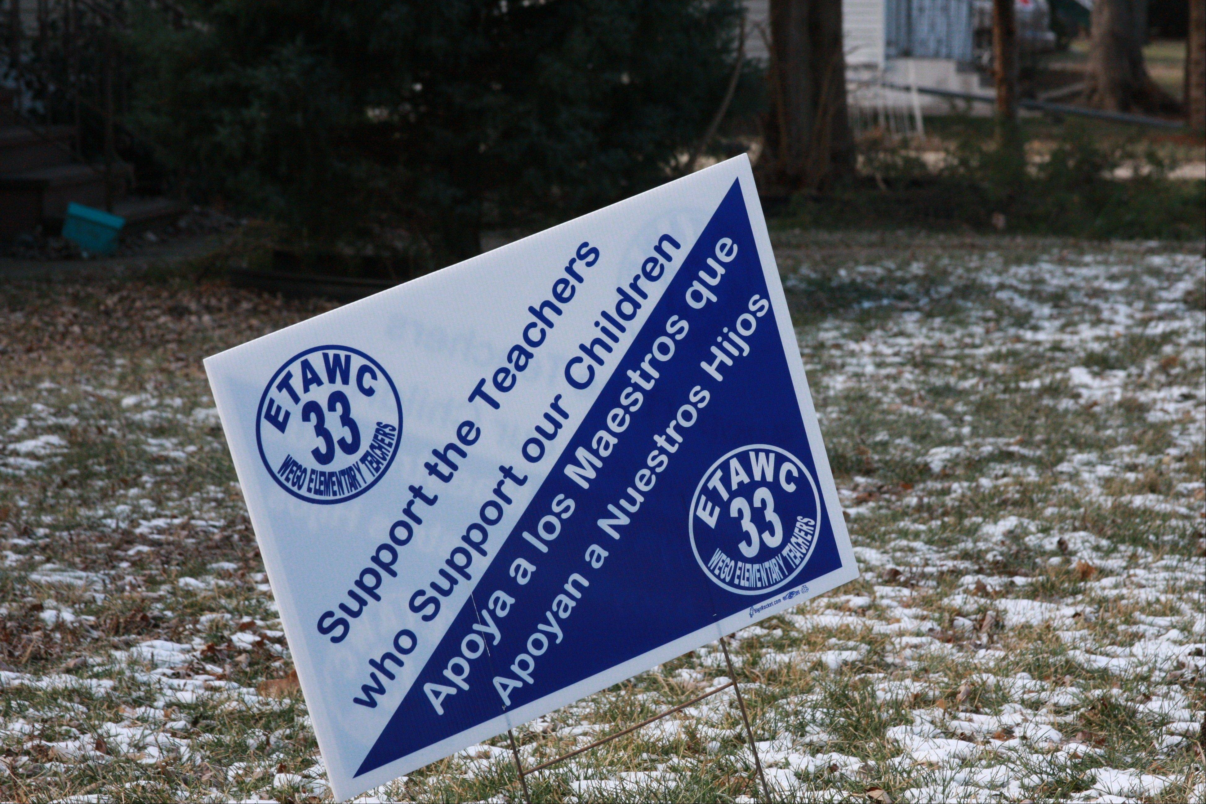 Signs supporting West Chicago Elementary District 33 teachers in their contract talks with the school board have been up for weeks in some yards.